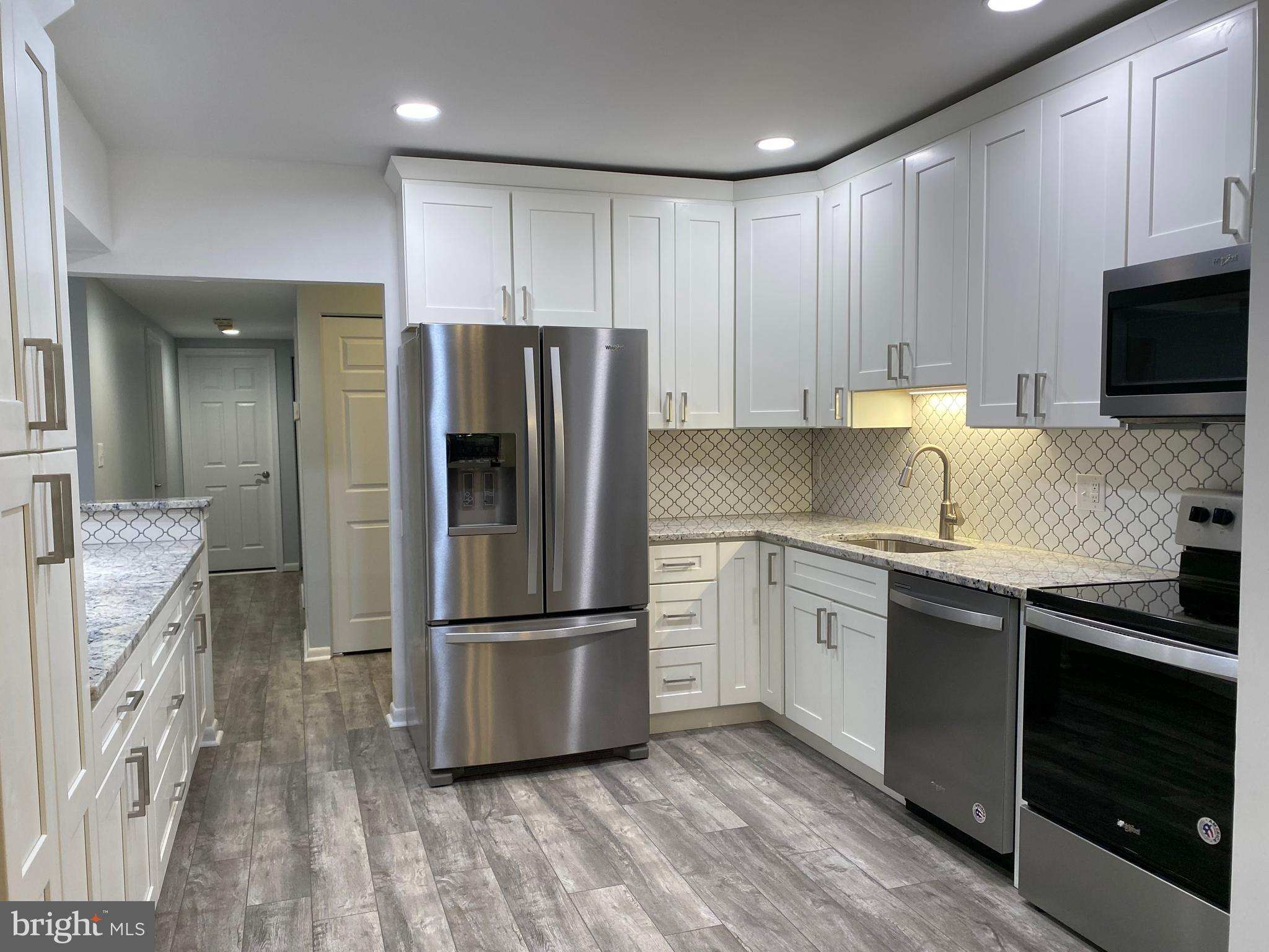 Highest and Best Offer due by 5pm on Tues. 9/28. Beautifully renovated Mays Chapel condo. This second floor 2BR/2BA unit offers many updates. Kitchen has gorgeous granite counter tops with seating along one side. New soft close cabinets with a pantry, all new Whirlpool stainless steel appliances, Moen fixtures. Luxury vinyl flooring throughout the kitchen, dining room, living room and hallway. Every room has been freshly painted. Living room has a slider that opens to a covered balcony for some outdoor space to relax. Additional storage closet off the balcony. New carpet in both bedrooms. The large primary bedroom has a walk-in closet. Beautifully updated primary bathroom with a marble double vanity and stunning tiled shower.  Spacious second bedroom with a closet. Second full bathroom has a granite vanity and has been newly tiled tub/shower.  Laundry room with shelving and additional storage space. All new Andersen windows . Convenient to major roadways shopping and dining. Don't miss out on this beauty.