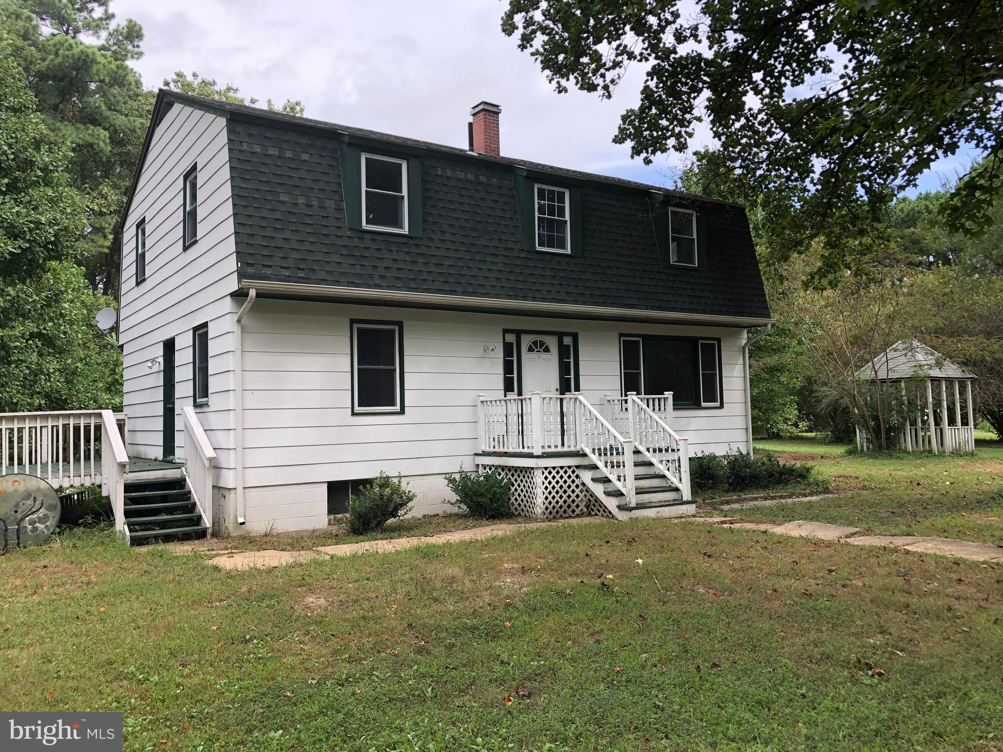 Nearly 7.5 acres with a park like setting.  Older 4 bedroom, 2 1/2 bathroom  home in need of repairs