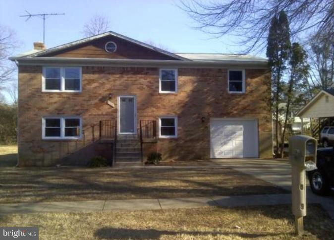 All Brick Split Foyer in Upper Marlboro. Features Four Bedrooms, 3 Full Baths, Separate Dining Room,