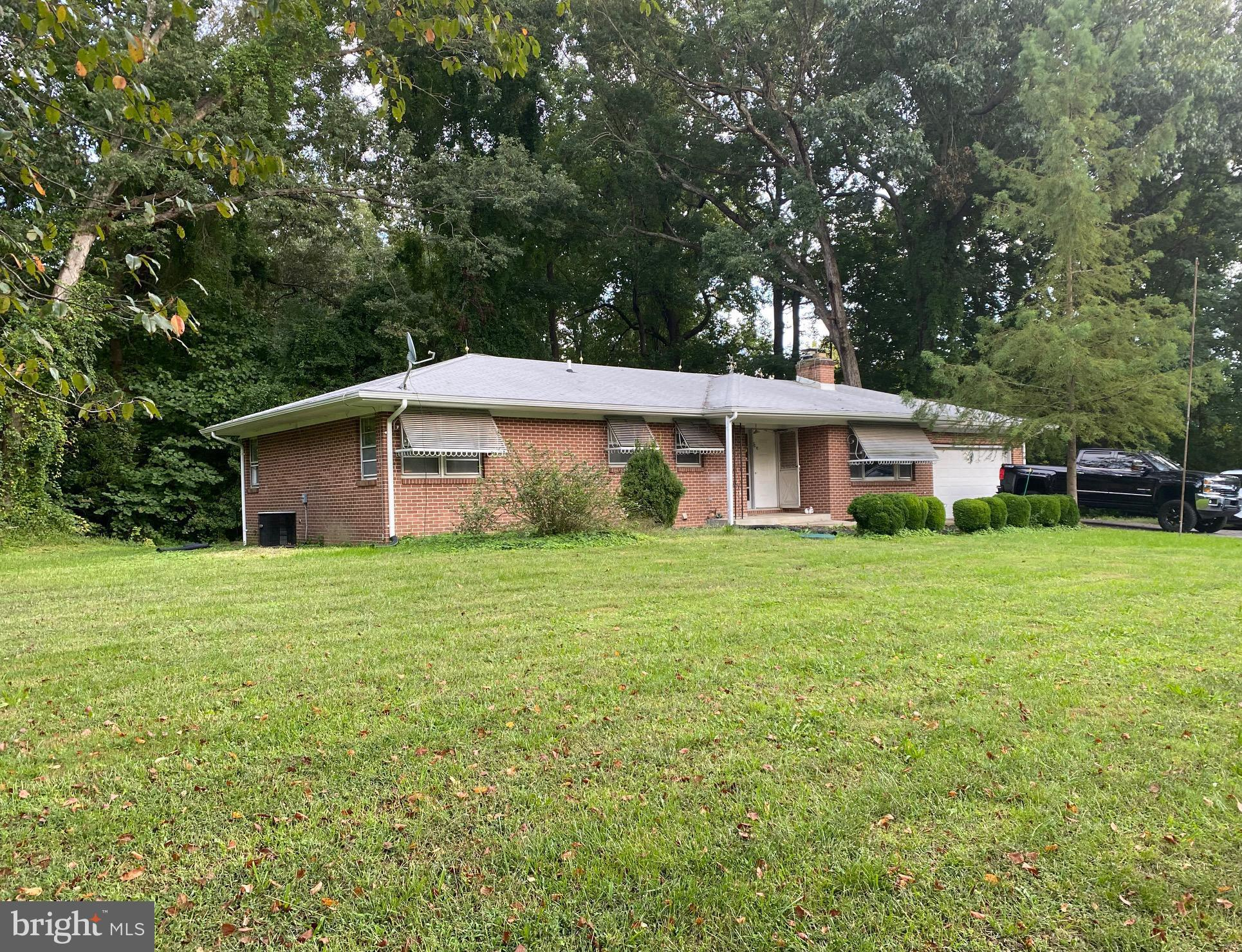 New Photos of Beautiful Home Coming Soon! This Solid All Brick Rambler on Two Acres in Northern Calv