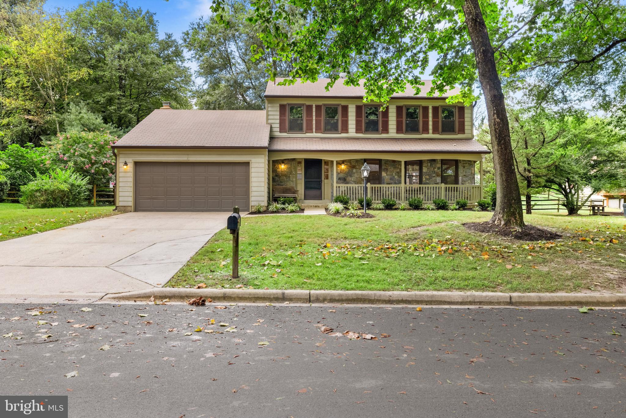 Welcome to this beautifully renovated colonial with inviting covered front porch, two-car garage, an