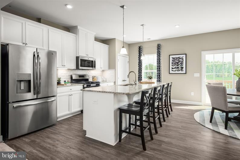 Welcome to the Mendelssohn, where the convenience of townhome living meets the amenities of a single