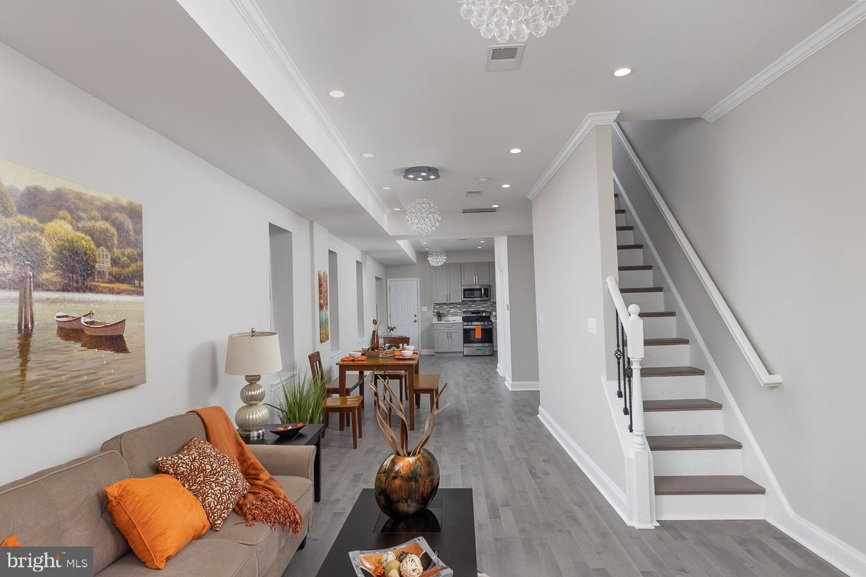 Welcome Home!!!...This fully rehabbed townhome is centrally located and accessible to all amenities.