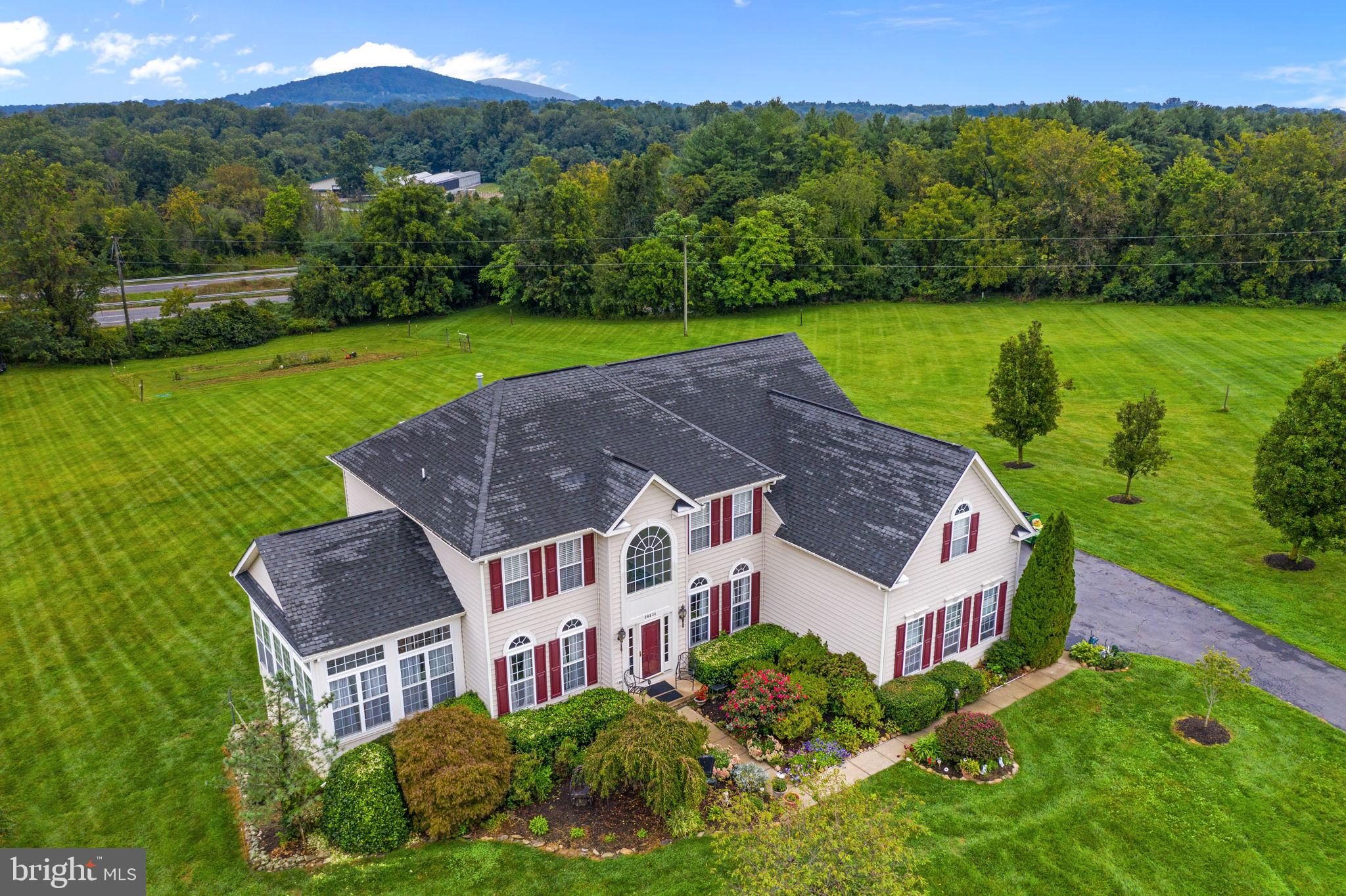 Ryan Homes Built Avalon Model in the Light Right Subdivision of Round Hill on 3.71 acres. 3 car side