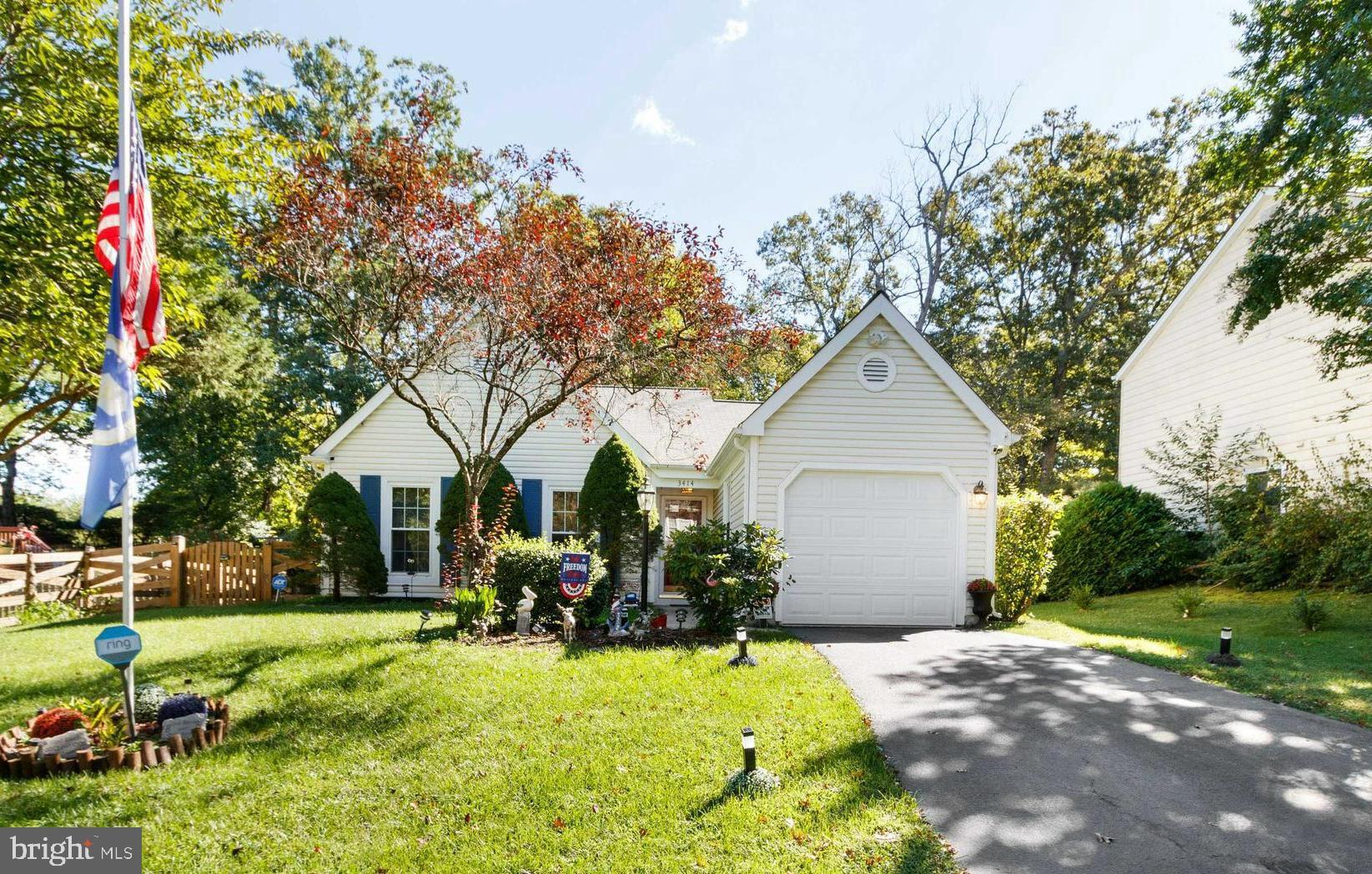 Take one step in the front door and immediately feel at home. This bright and open three-bedroom two
