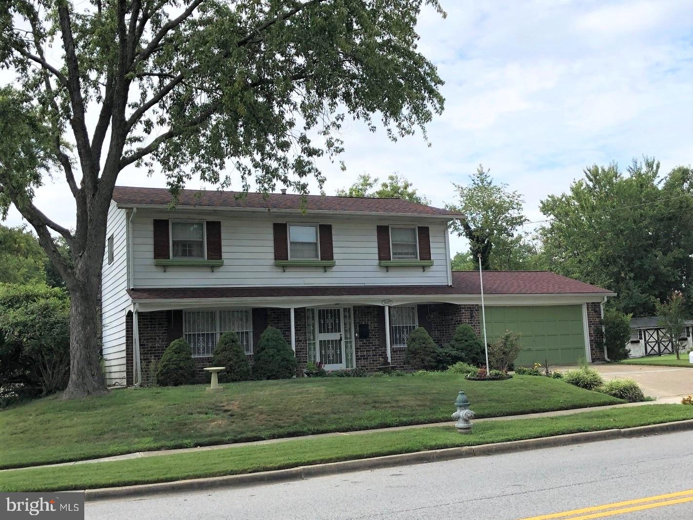 Fine two-story home on a corner lot with a brick first floor, full basement, and a two-car garage. T