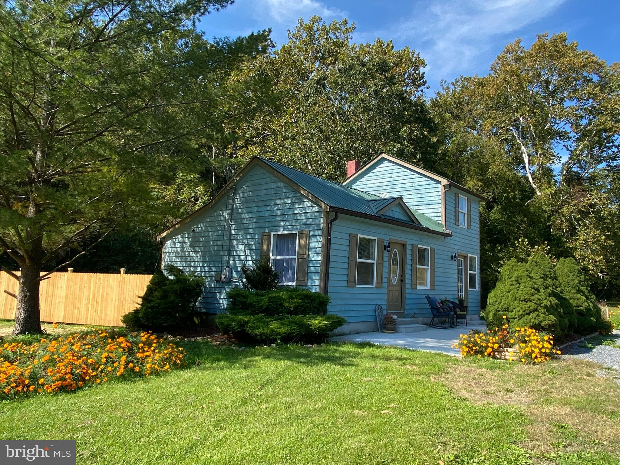 THERE ARE NUMEROUS POSSIBILITIES WITH THIS ADORABLE HOME WHICH IS LOCATED RIGHT ACROSS THE STREET FR