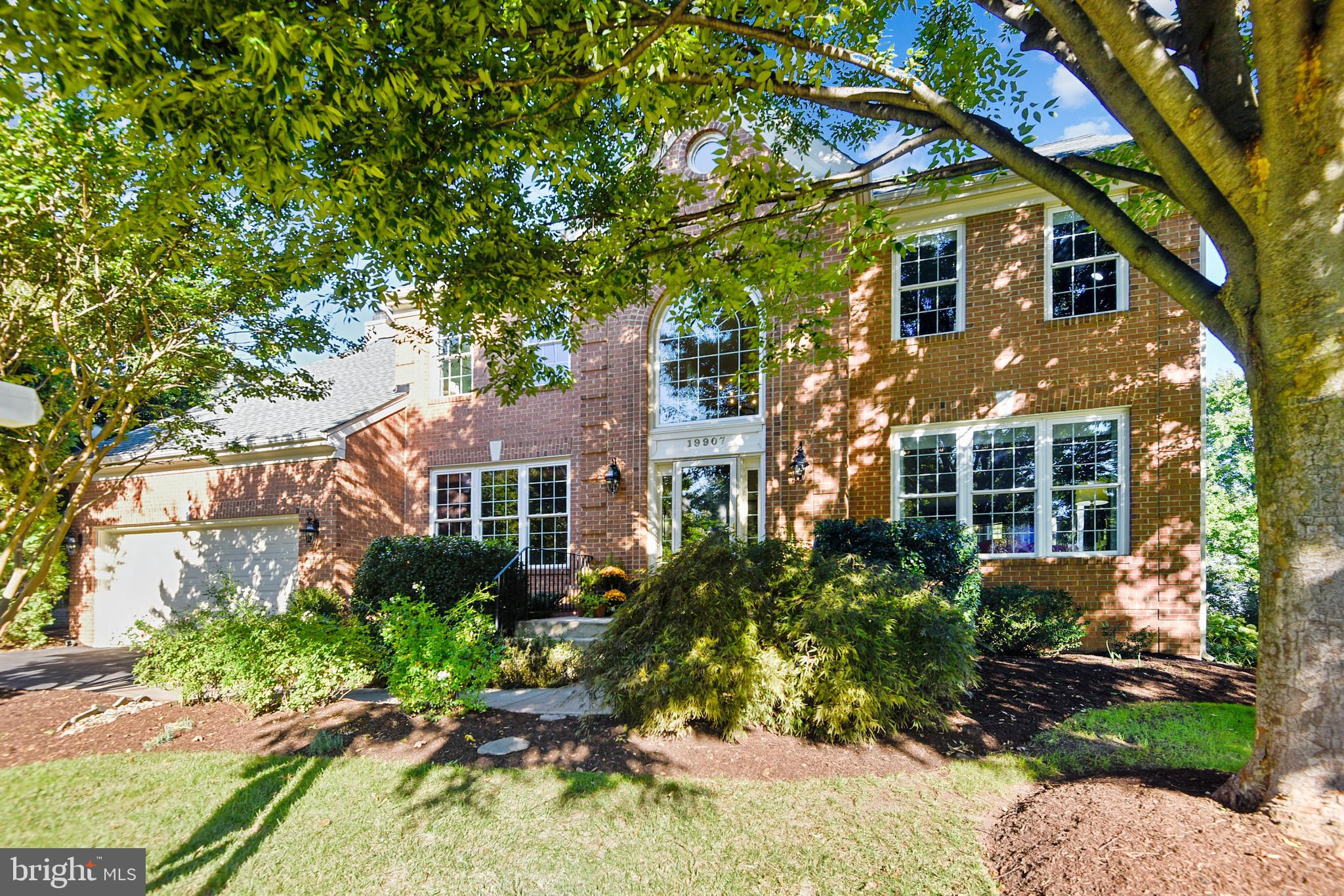 Welcome Home!  This elegant brick front Colonial style home will simply wow you with its tasteful de