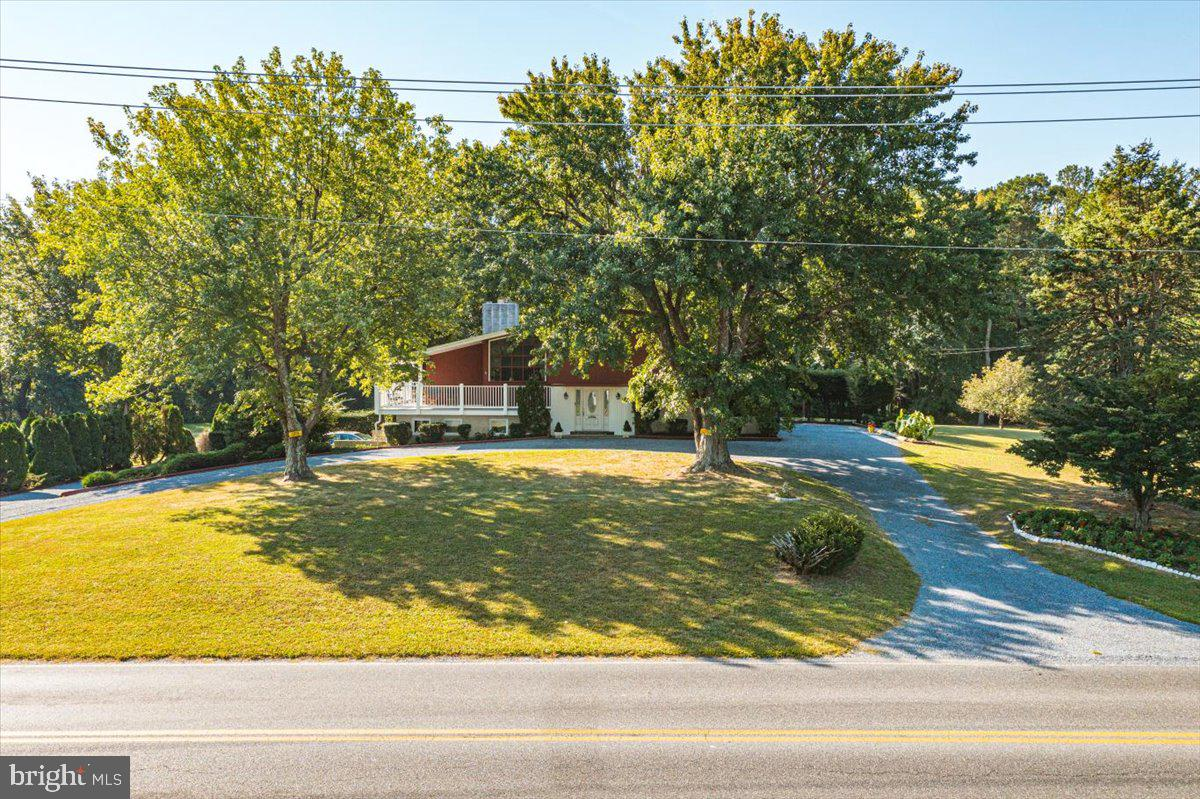 Great Home with a ton of potential! Mature landscape and more than 3 acres! Home is being sold AS IS. 3 bedrooms 1.5 bathrooms, paved parking pad, on an otherwise stone driveway with ample parking.  Side entry garage promises additional storage and a shed out back as well.  Great place to entertain!  Enjoy the proximity to the West Ocean City Harbor, great restaurants and attractions.  Great spot to let kids and pets run and play!  NO HOA!