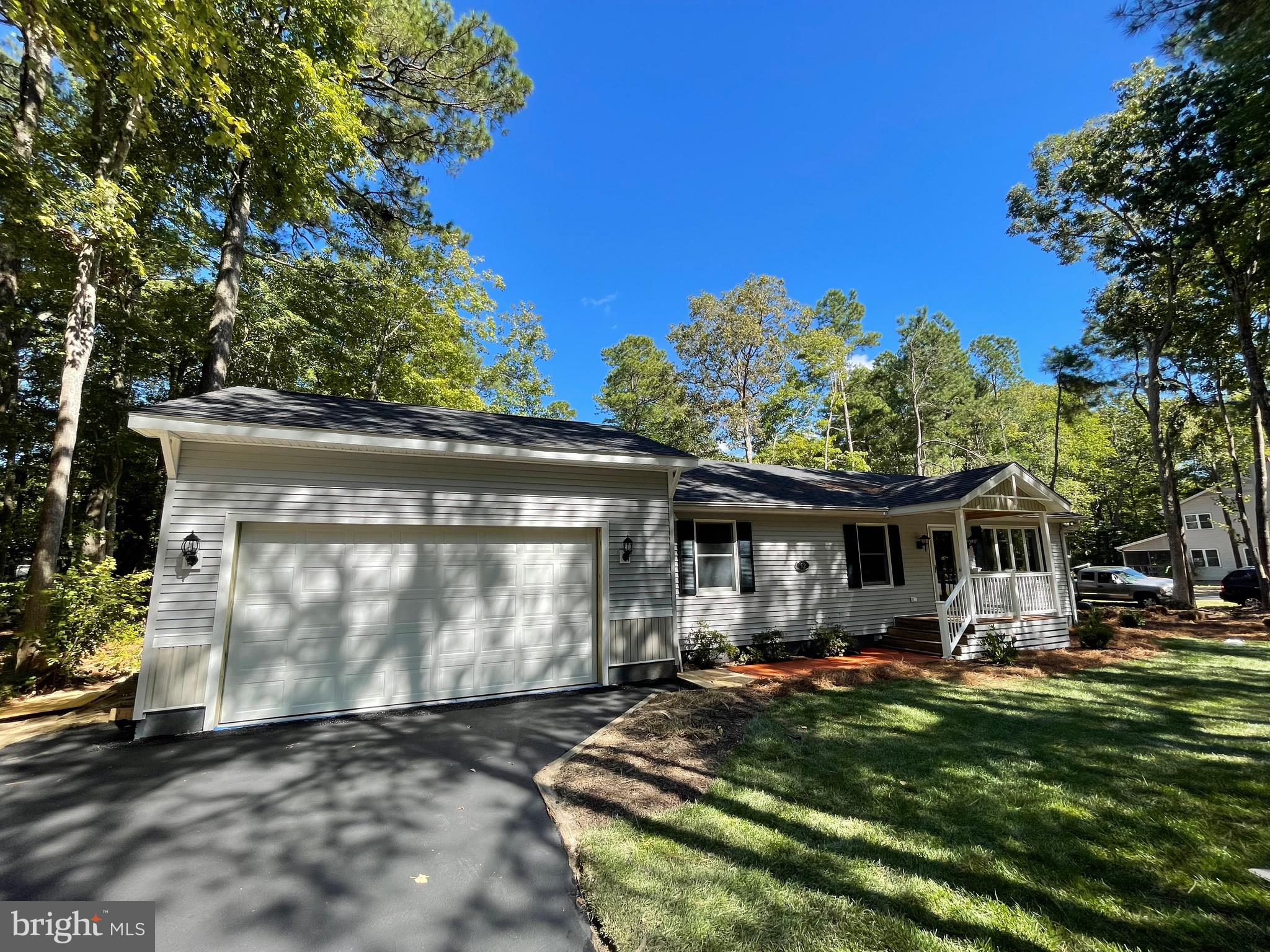 Open House Saturday, October 23rd. 10am to Noon. Spacious Rancher on large oversized corner lot in South Side of Ocean Pines. Home is in Excellent Condition and Turn Key for immediate occupancy. Very open floor plan, Lots of natural light, Fenced in rear yard with storage shed,  2 Car Garage, Side Yard offers room to add a Second Driveway off of Camelot. Many recent updates,Freshly painted,  New Kitchen Appliances, New Luxury Vinyl Plank Flooring, Granite Counter Tops, Updated Bathrooms, 2 Rear Decks, The Roof, Water Heater and HVAC were replaced a few years ago. This home could be yours. AMERICAN HOMES SHIELD ONE YEAR WARRANTY INCLUDED.