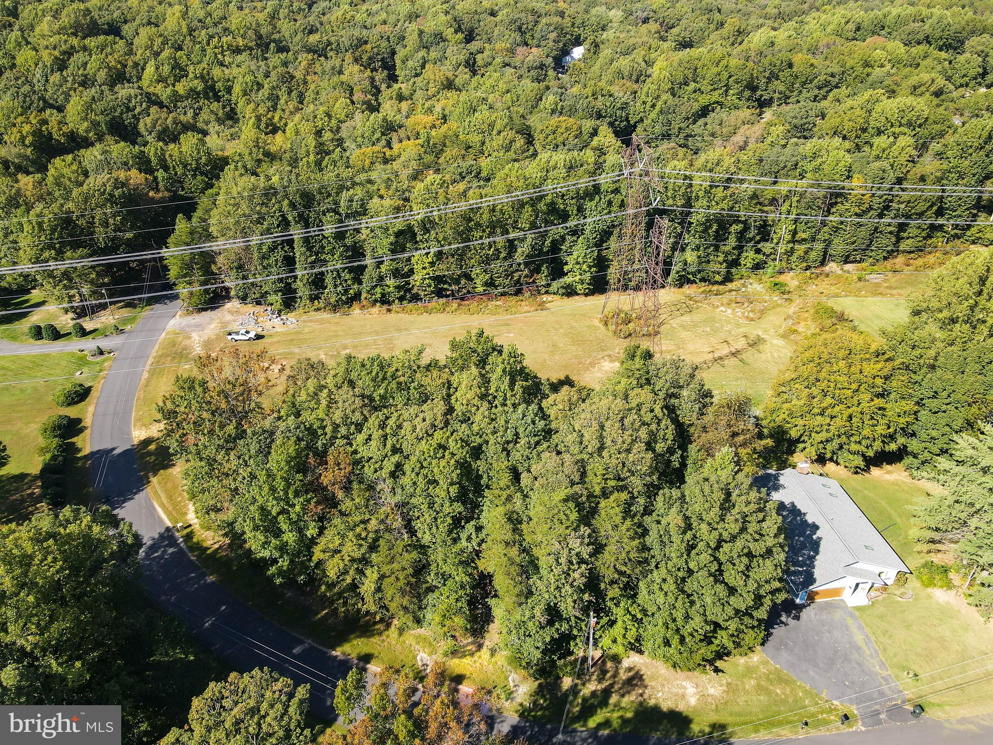 almost 2 acres!  Plenty of space to build your dream home.  Open area with additional privacy on the sides