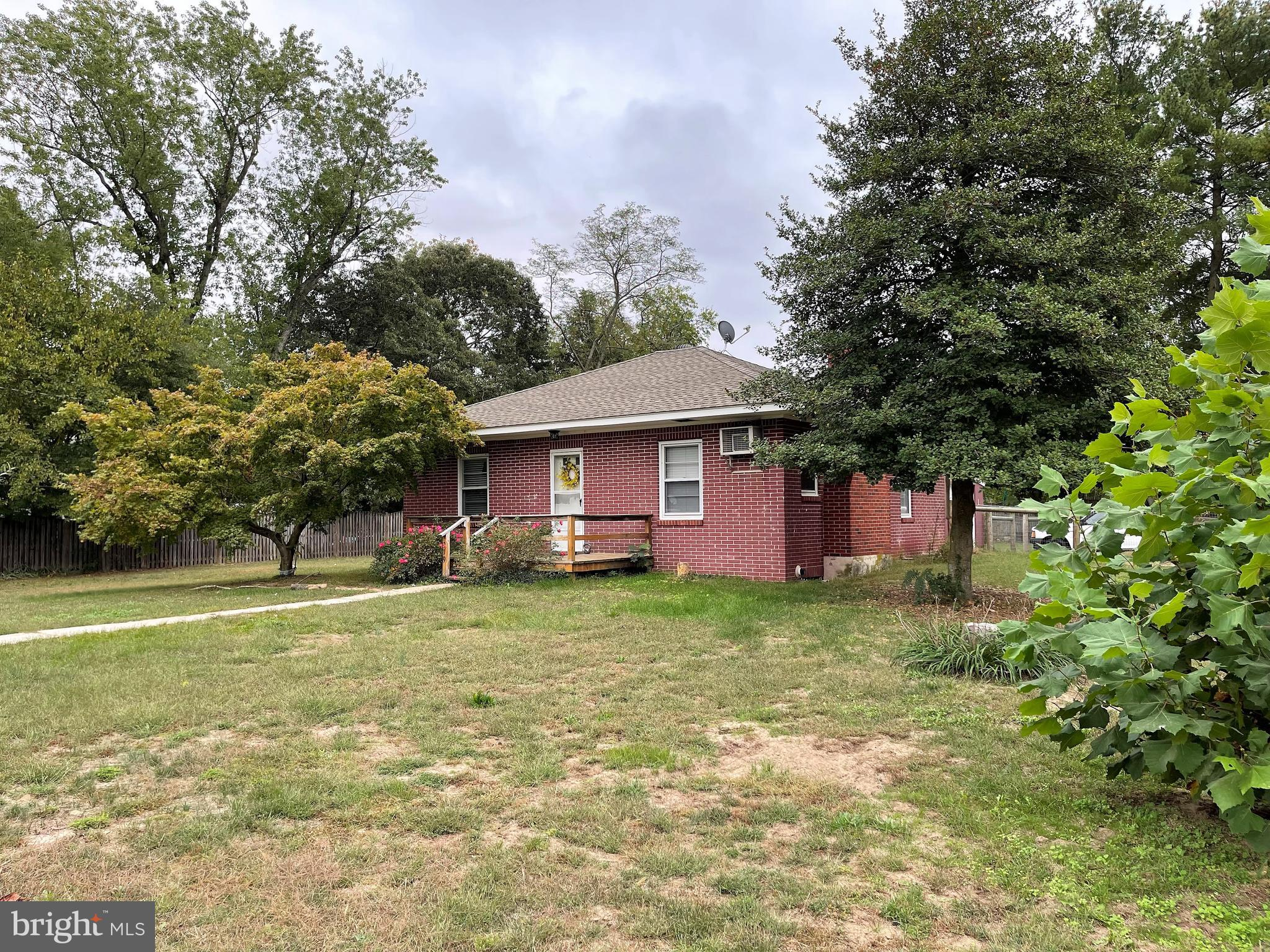 The simple pleasures of one level living, low maintenance all brick home on large corner lot, 2 bedr