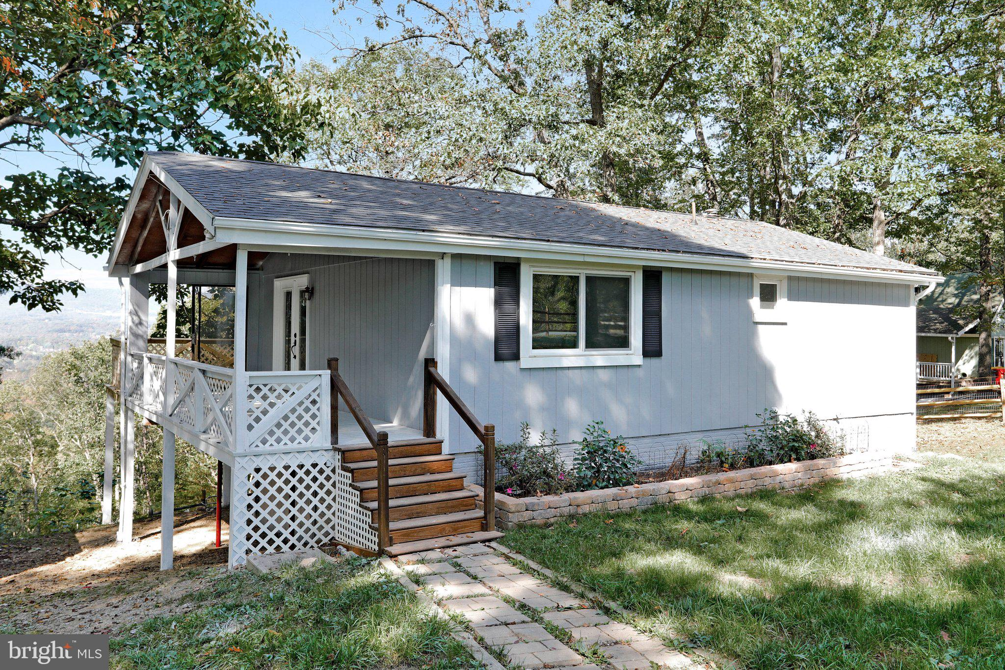 Looking for privacy but not total seclusion? Check out this 2 bedroom, 2 bath home on 1.34 acres loc