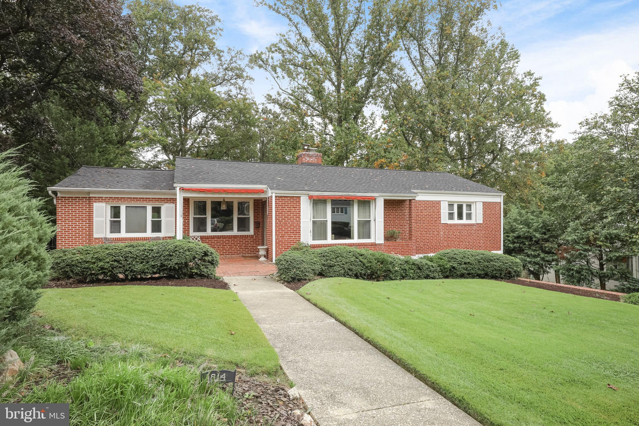 What an opportunity!! Great West Towson brick rancher with lower level one car garage. Traditional layout - beaqutiful hardwood floors throughout,  Living Room with wood-burning brick fireplace. Layout has primary bedroom suite to the left of the entry (bedroom, bath and sitting room), and two other bedrooms with  full bath to the right of the living room. A sunroom addition off the back overlooks the fabulous private rear yard.  Lower level has large clubroom, craft area, laundry area and access to the lower level garage. Also  rear walkout door from the garage, and a full rear window letting in that natural sunlight. Rear patio & yard a must see. Home needs updating (hardwood floors in great shape though), but wonderful potential. The roof, HVAC system, and hot water heater are all newer! Good bones!