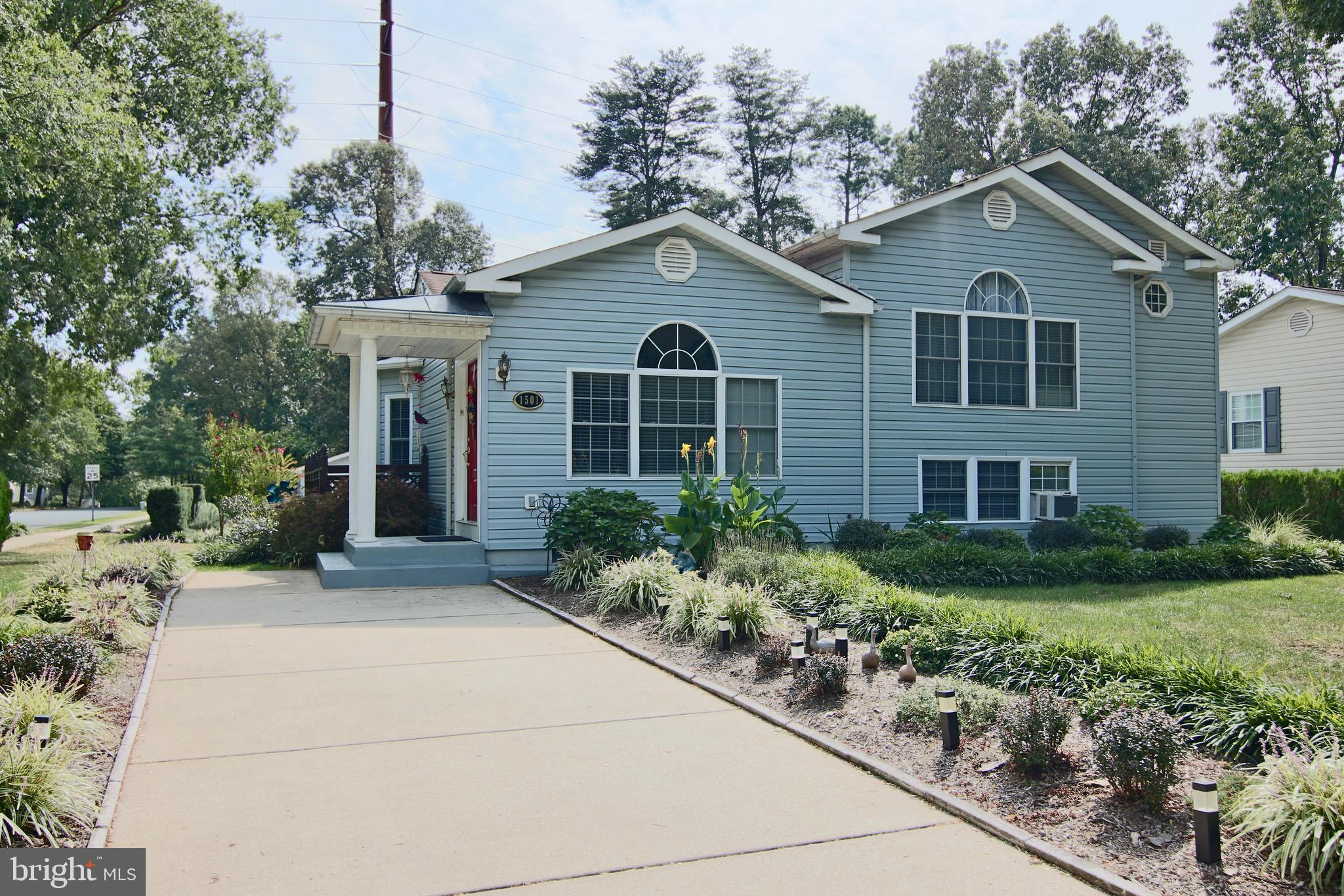 Welcome to this unique craftsman updated split level home with an open floor plan and oversized 3 ca