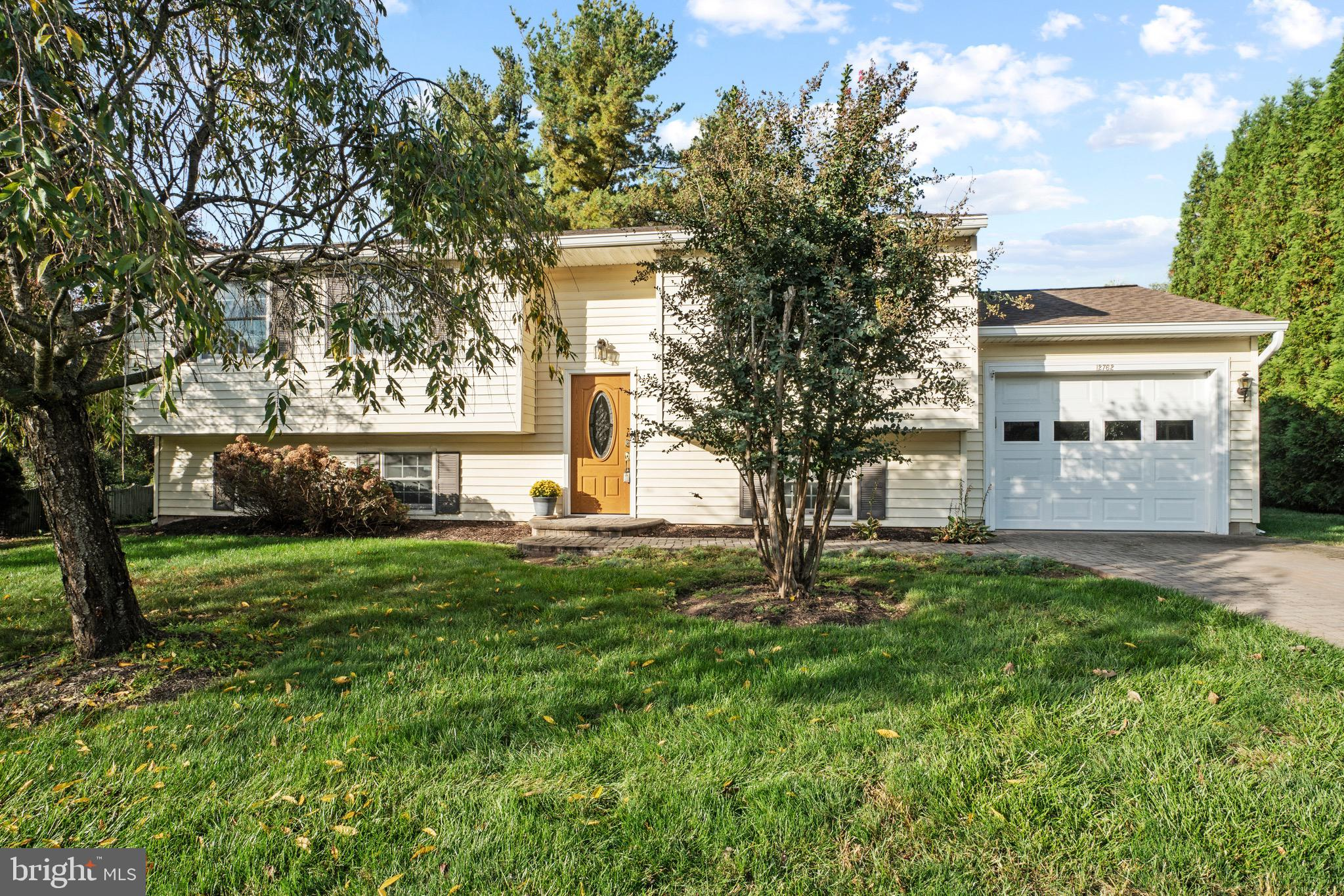 PROFESSIONAL PHOTOS COMING TUESDAY 10/26! Charming 3 bedroom/2 full bath home on a pretty .26 acre l