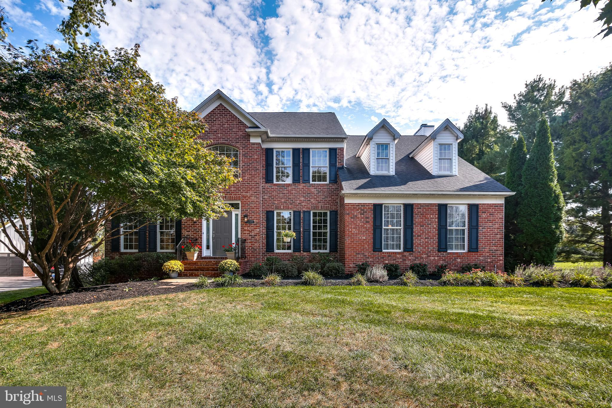 You'll love living in Fulton Manor! This gorgeous brick front home sits on over one acre in a great