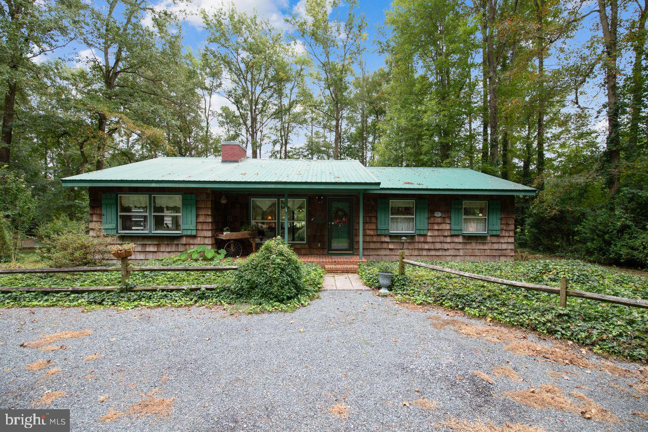This quiet retreat-like property nestled on 2.3 meticulously landscaped and wooded acres with its ow