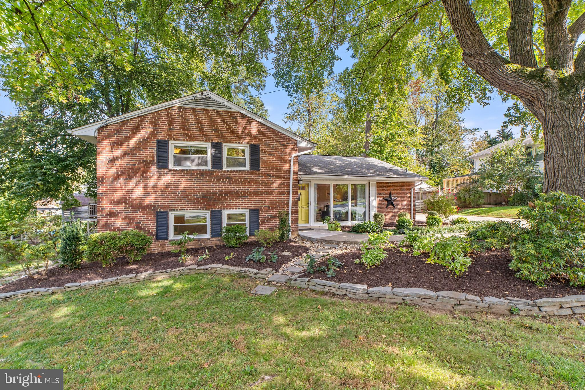 Wonderful North Springfield Split Level. Huge sliding glass doors allow view of large deck and spaci