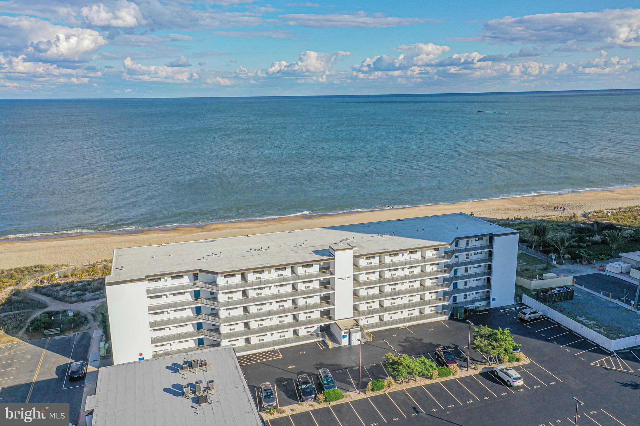 First floor south corner end unit with Ocean View. Private Ocean Front Balcony with Hurricane Shutters. Gate at railing for easy beach assess . Fireplace in living room . Updated Air/Heat 2017. This location is close to Shopping, Restaurants,  Bars and Fitness Gyms. (( Professional Pictures to be Added by 10/18/2021 ))