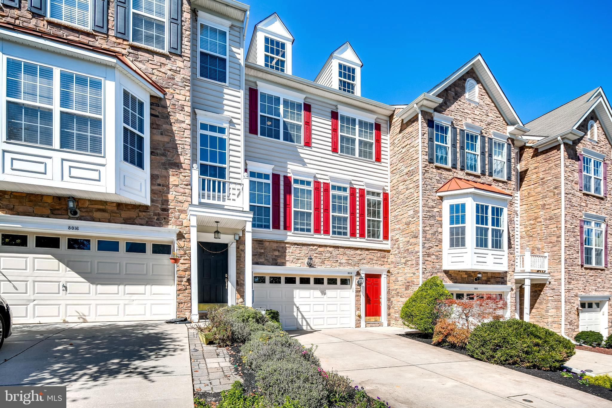Sited on a quiet and private lot with beautiful views, and well cared for, this luxury townhome is m