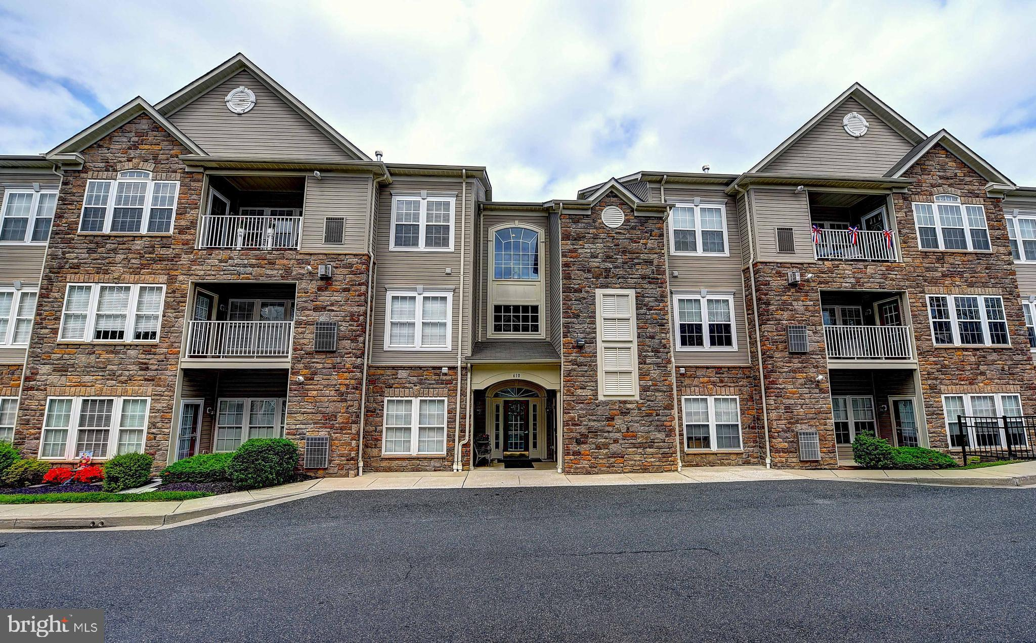 """MOTIVATED TO SELL!!! ... Don't miss this one! Make yourself right at home in this beautiful & well cared for 55+ condo in the sought after Moore's Mill Crossing.  Offering many fine features and amenities with  two spacious bedrooms including an owner's suite with a wonderful sitting room and huge walk-in closet, as well as, a large owner's bath offering a walk in shower with built-in bench, a double bowl vanity & more.  The spacious living room provides plenty of space to entertain family and friends and opens to a large dining room.   You'll love the kitchen with 42"""" maple cabinetry,  Corian countertops, Travertine backsplash, and breakfast bar.  A light filled sunroom is just steps from your kitchen and living room and offers a French door to your own private balcony.  A secure entrance provides peace of mind and an elevator provides easy access to your home. Don't hesitate...be ready to call it HOME today!"""