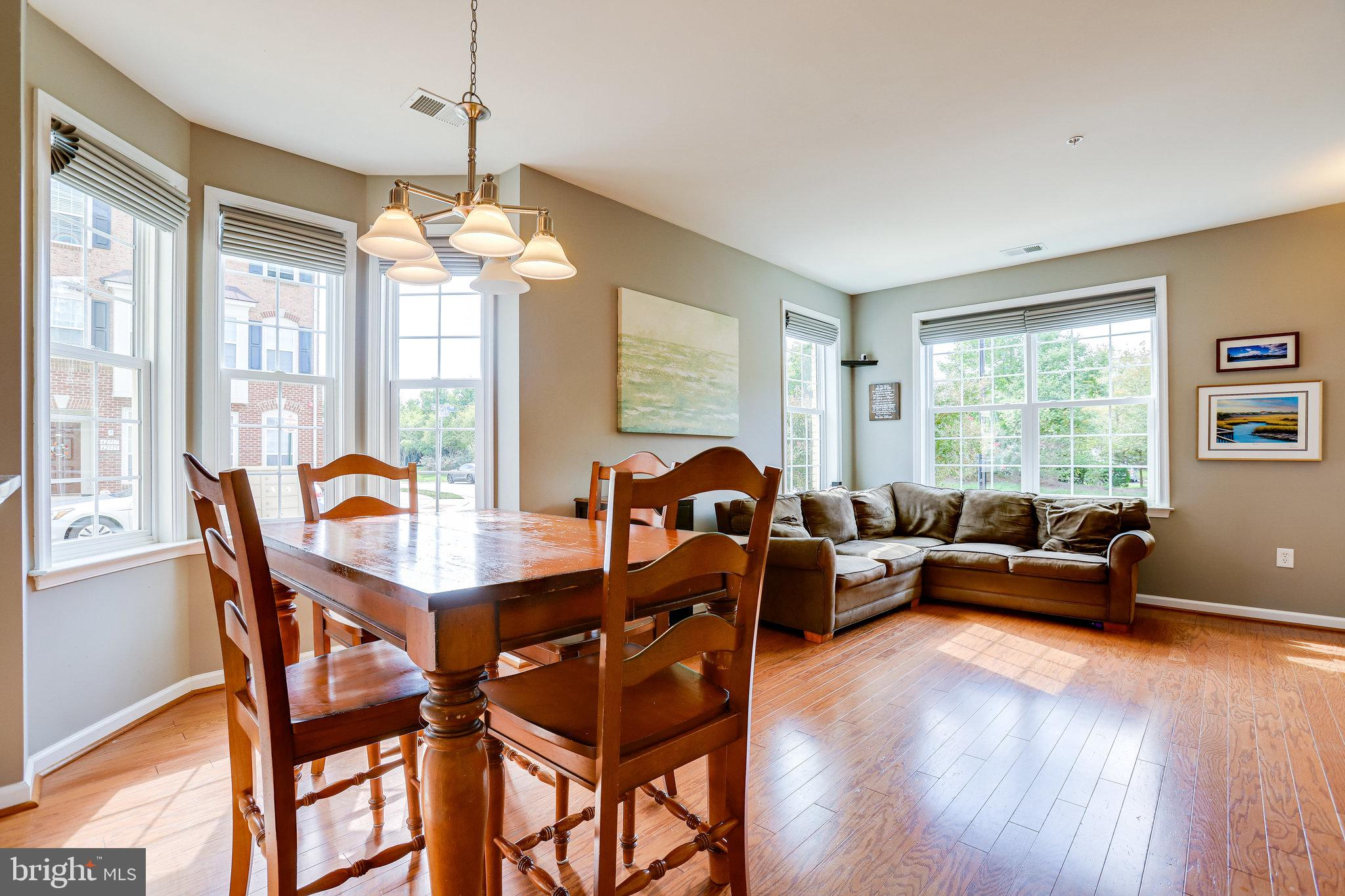 Surrounded by excellent schools, great shopping and dining this 2-level end unit condo in Brambleton