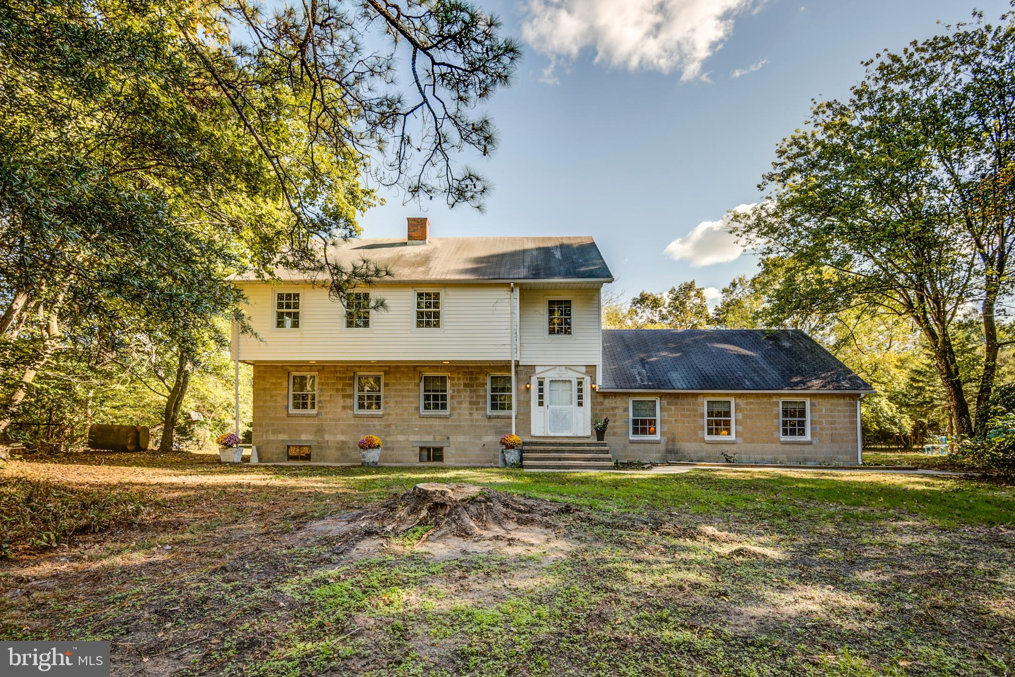 Nestled in the quiet countryside of Greenwood, this gorgeous Colonial-style home boasts 2,900 square