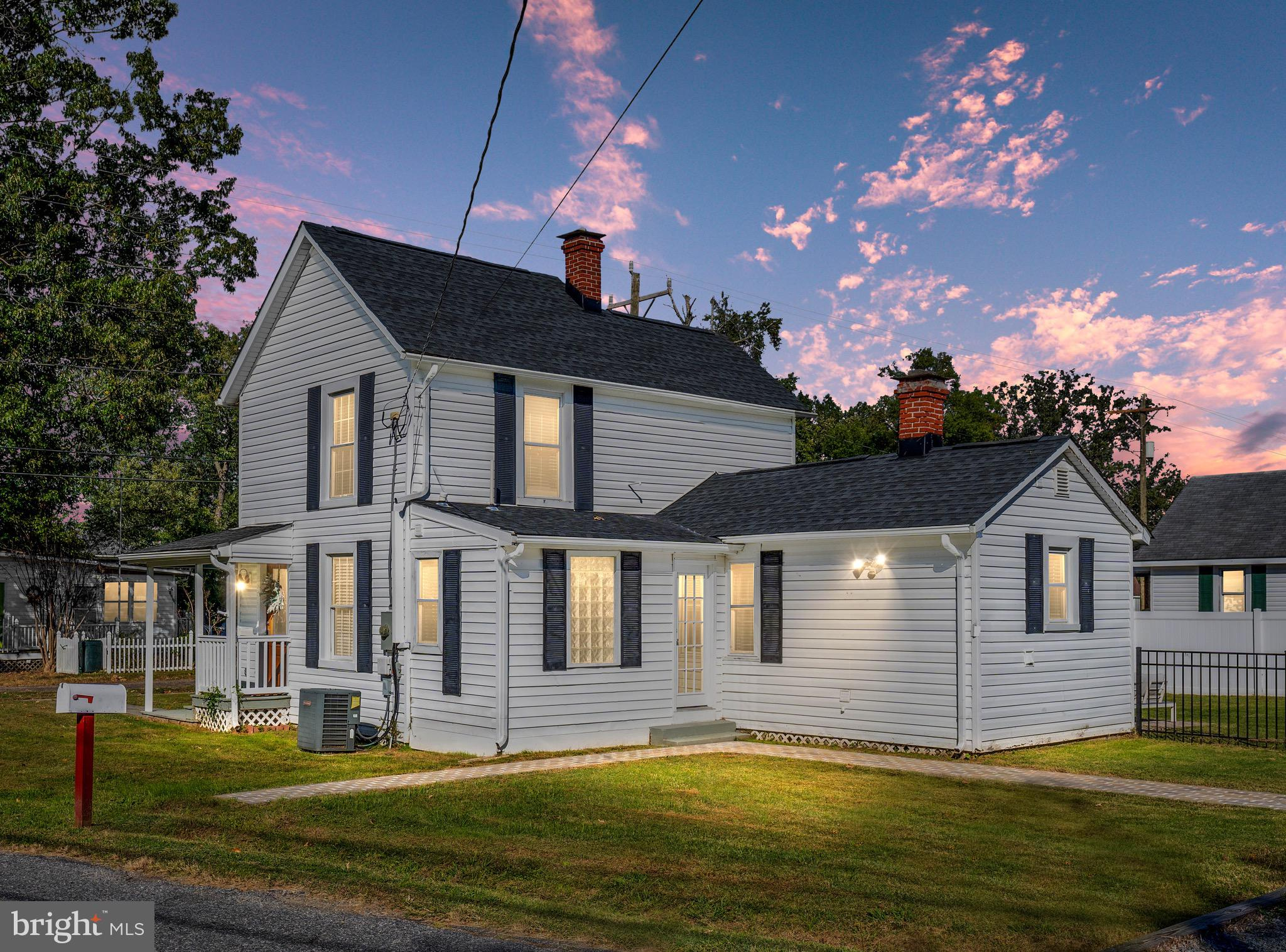 Built in 1930, the Storybook House is a charming farmhouse sitting right on the point of Colonial Beach, VA! The house has been newly renovated with a modern touch to feel bright, open and welcoming! Home sits on a corner lot with water view, the outside features spacious fenced yard with vinyl privacy fence, a large shed with space for golf cart, brand new custom patio + walkways, new driveway with space for 4 cars and a comfy front porch with rocking chairs. Recent interior renovations include: fresh paint throughout, front door, farm door, kitchen island & backsplash, light fixtures, washer/dryer & more! Also features hardwood floors, a spa bathroom with soaking tub, open concept floor plan & incredible natural lighting! Fantastic location within walking distance to the beach and restaurants on Washington Ave, this house is perfect for a summer home or a peaceful full-time refuge.