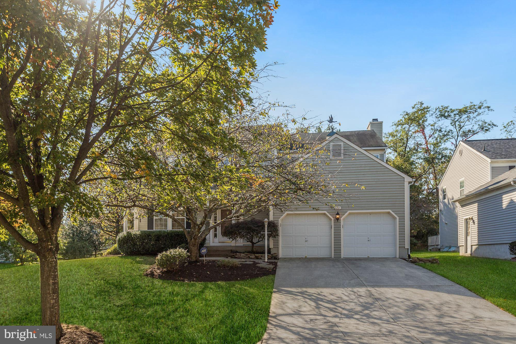 Gorgeous colonial style home boasting lofty windows, light filled interiors, classic moldings, state
