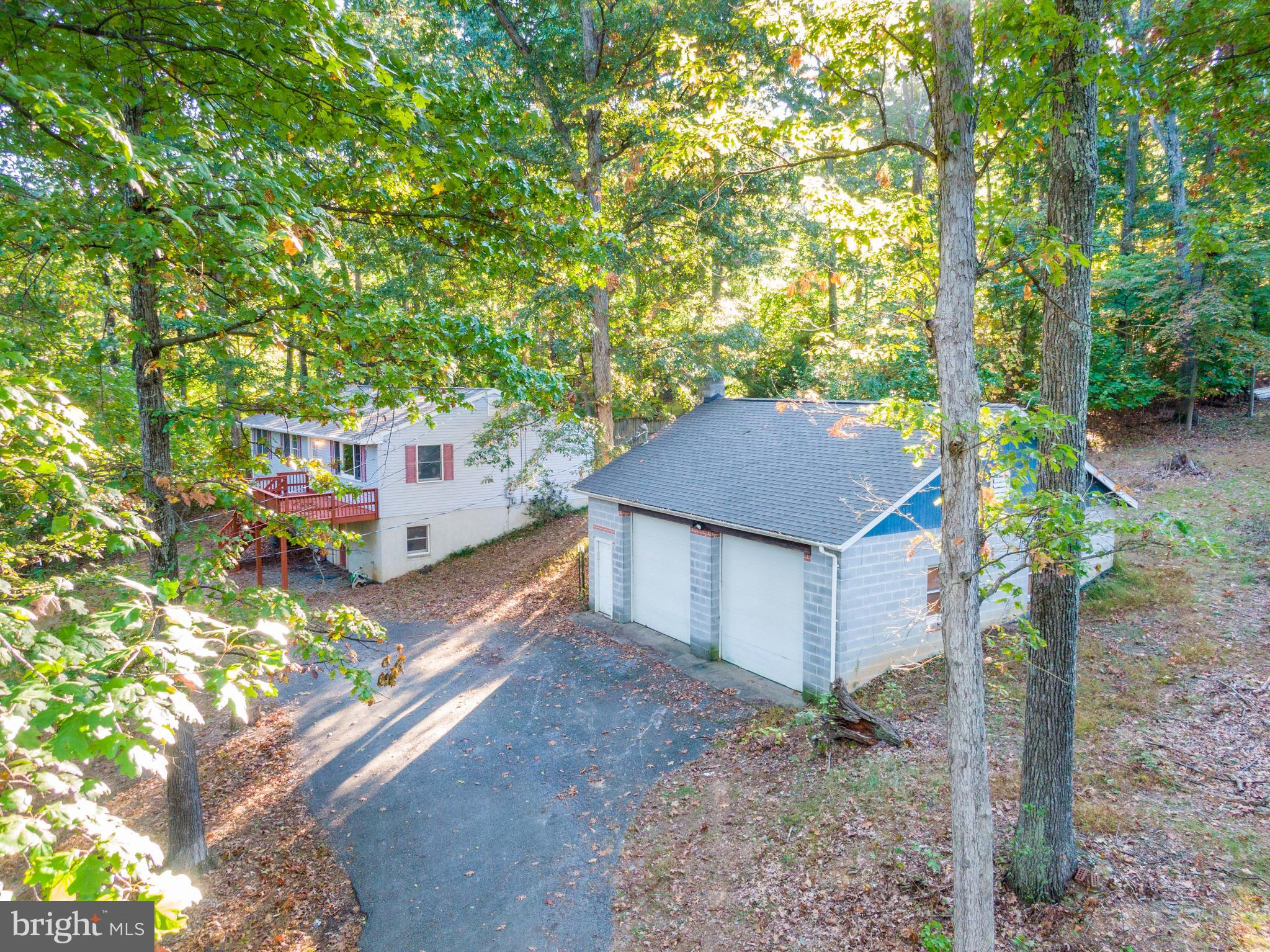Come check out this super spacious raised-ranch home nestled the woods, but just off Gate One in the