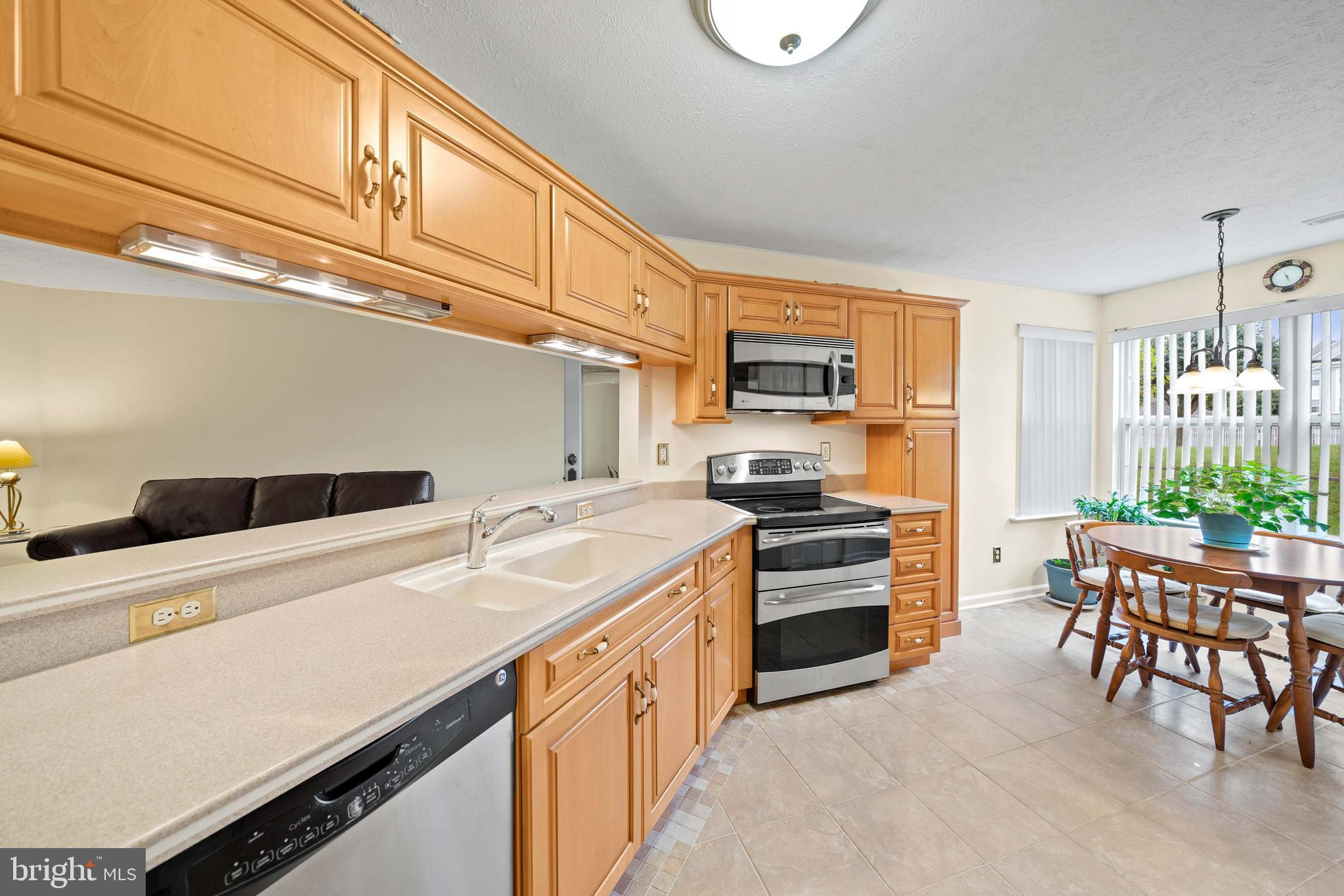 Live Authentically. Classic, light filled, 2 bed, 2 bath condo with updated kitchen in the Bayland C