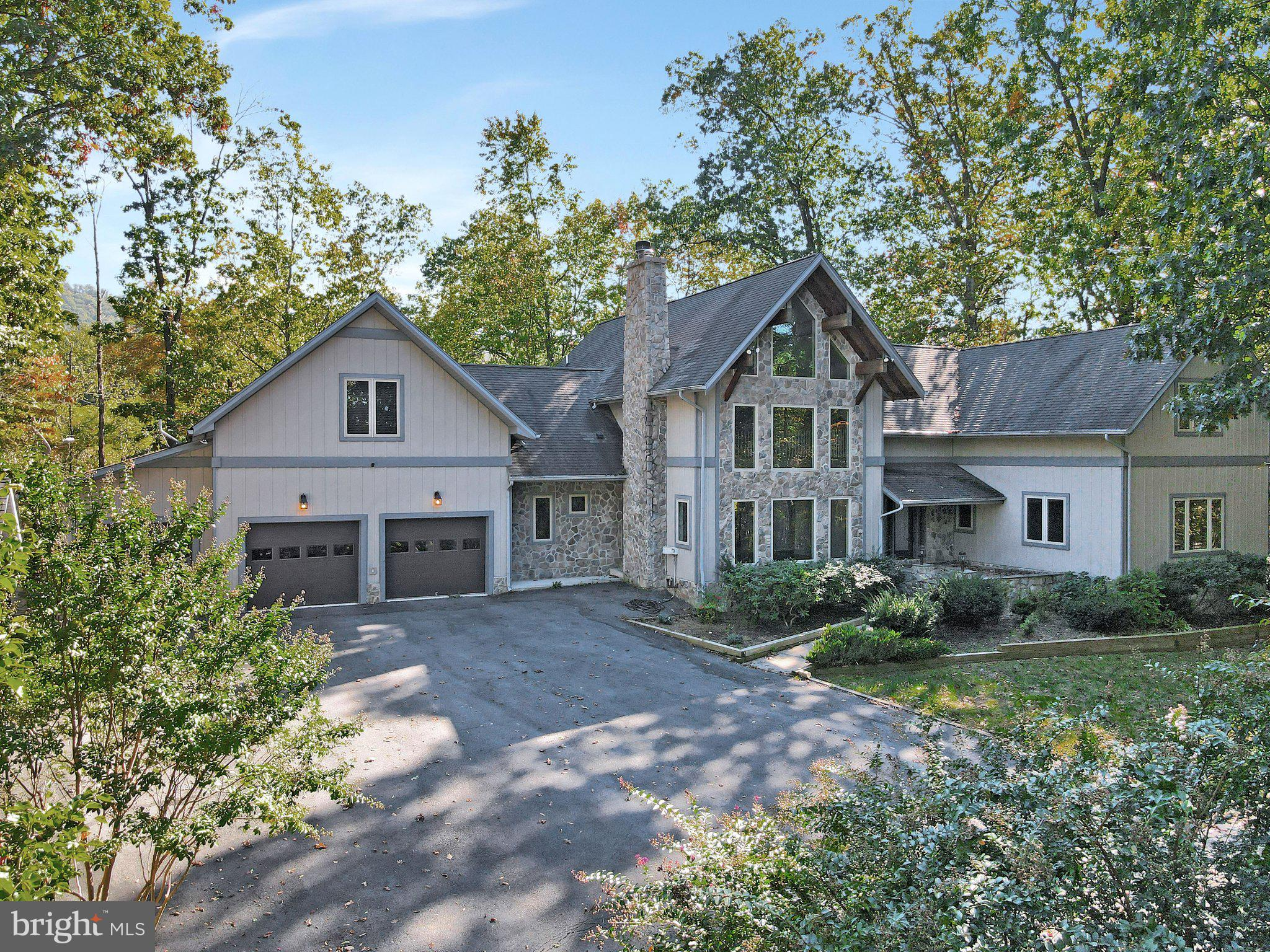 Magnificent estate on 5.3 acres in exclusive Round Top Estates.  This home features an open floor pl