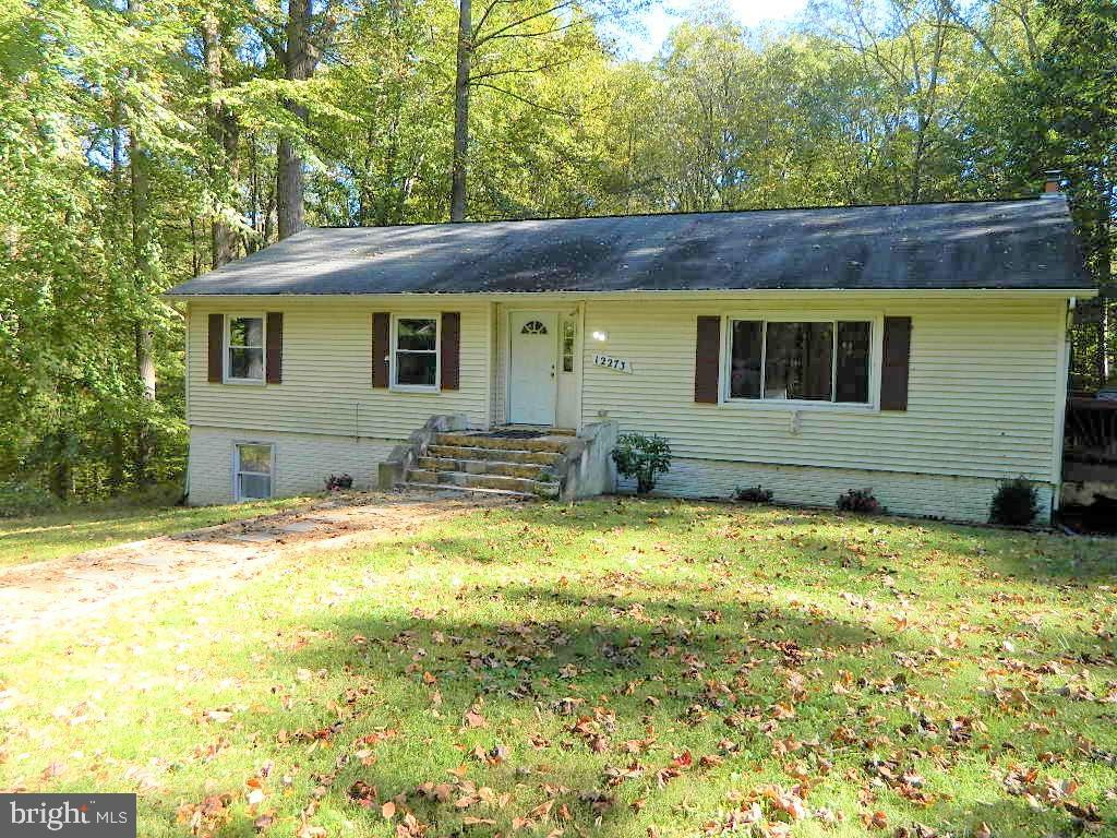 """THIS BEAUTIFUL RAISED RAMBLER/2 LEVEL COLONIAL  SITS IN A COZY WOODED PRIVATE SUBDIVISION. PRIVATE ROAD.  VERY SECLUDED, NO HOUSES IN SIGHT.  NEEDS TLC TO BECOME A GEM!  TENANTS ON SITE 24 HRS NOTICE.  ALL SYSTEMS ARE IN WORKING CONDITION. BUT THE PROPERTY IS """"SOLD AS IS"""".  PAID HOME WARRANTY AVAILABLE FOR THE RIGHT OFFER."""
