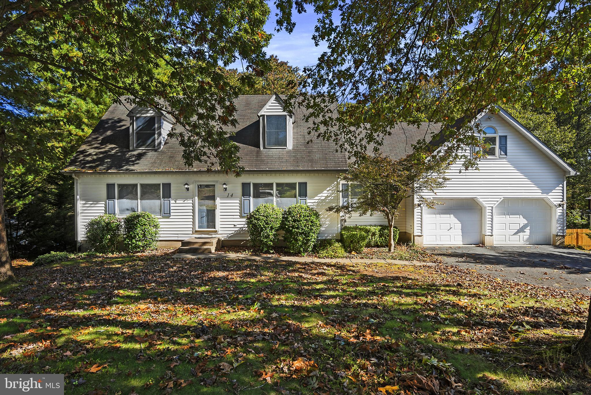 This four bedroom two bathroom Cape Cod house with two car garage situated on .778 acres in the desi