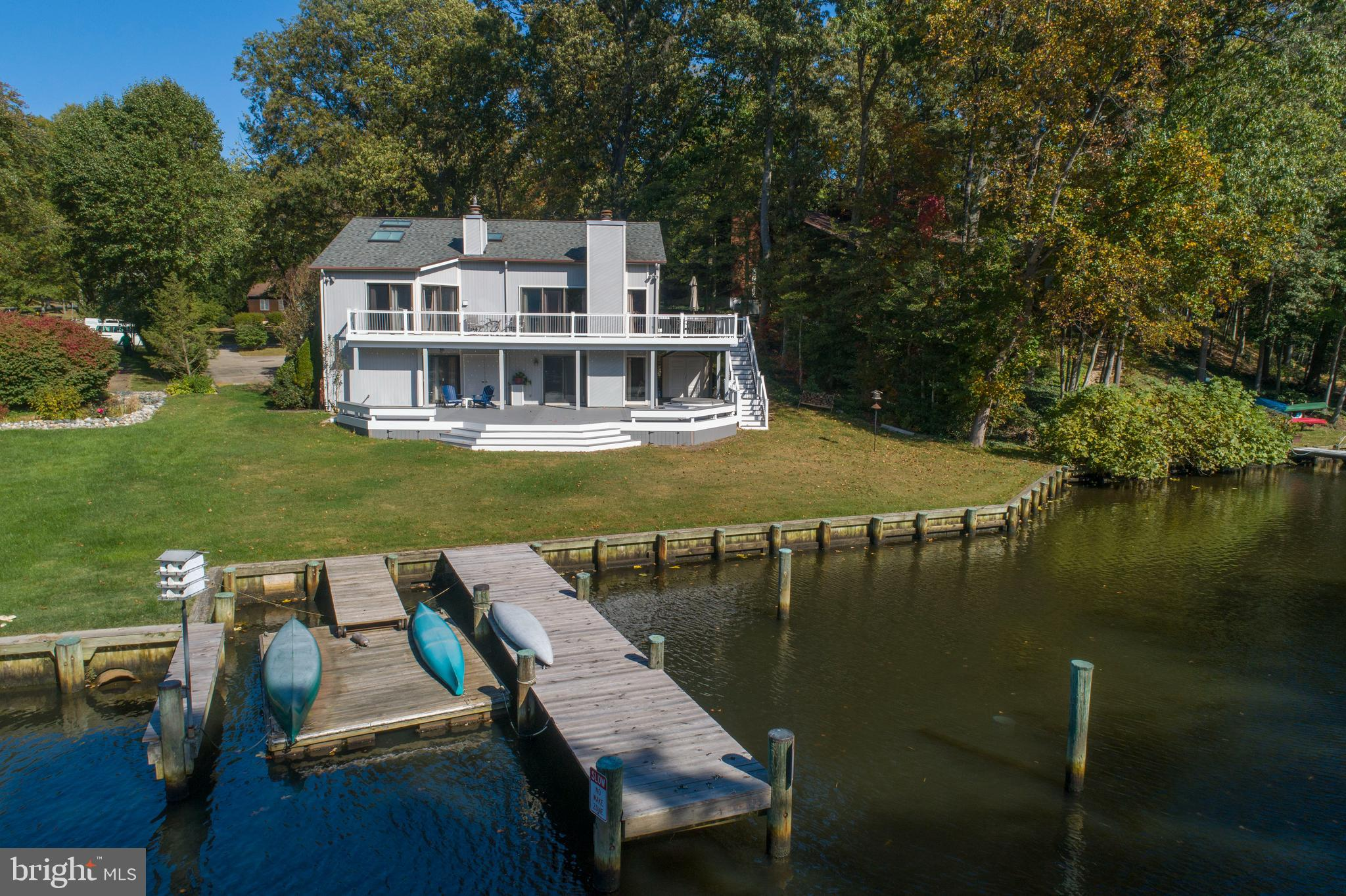 Welcome to 129 Berrywood Dr! This waterfront home is located in the highly sought after Berrywood co
