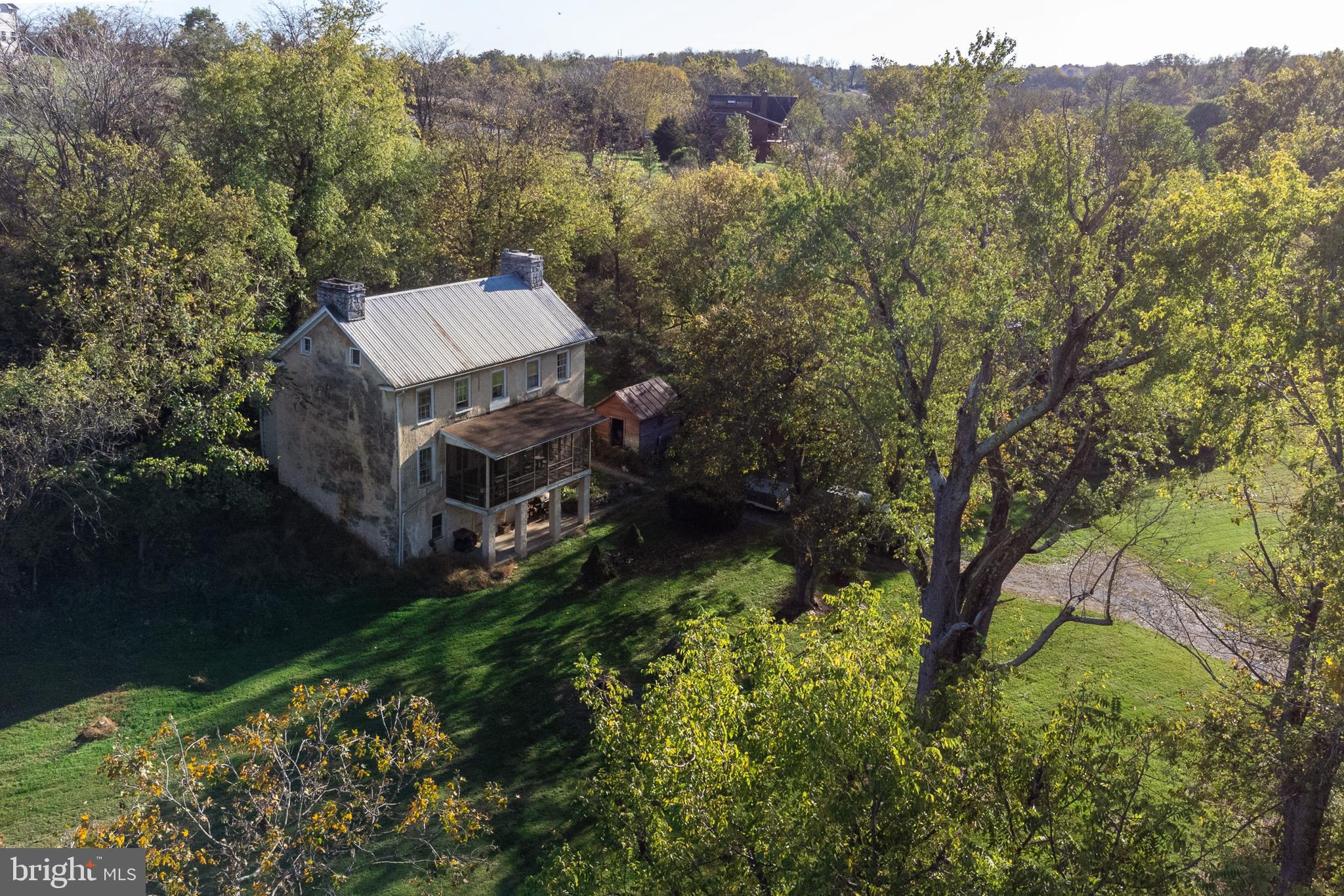 Historic home is situated on beautiful 8 plus acres in Little Georgetown with stream and access to g