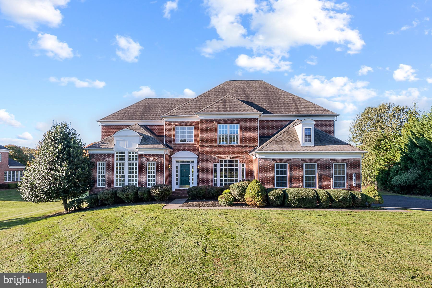 Welcome to this beautiful brick front colonial in Howard County with over 6,800 finished square feet