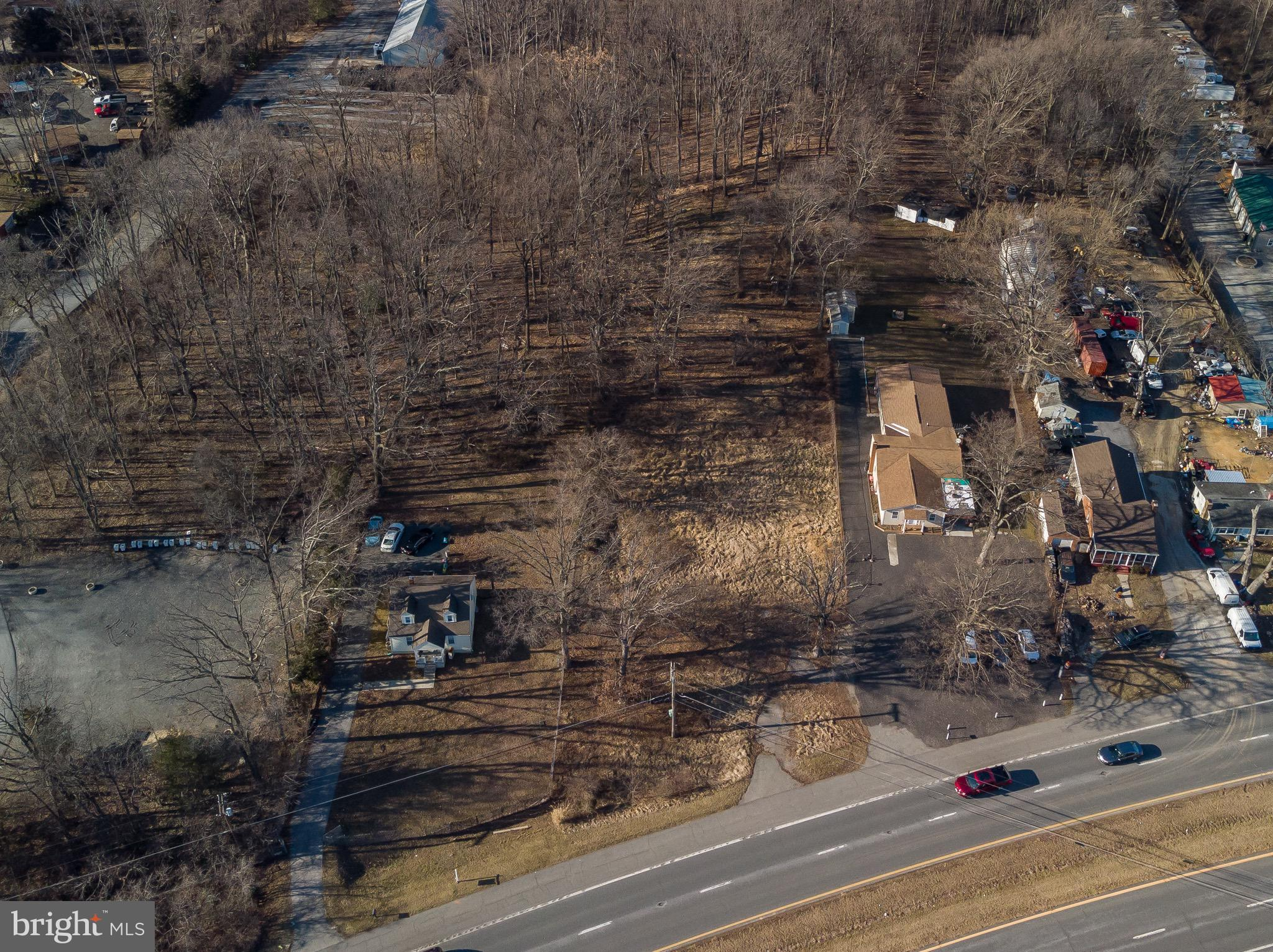 ATTENTION ALL INVESTORS, BUILDERS, AND DEVELOPERS! The value is in the TWO parcels of land - 16100 a