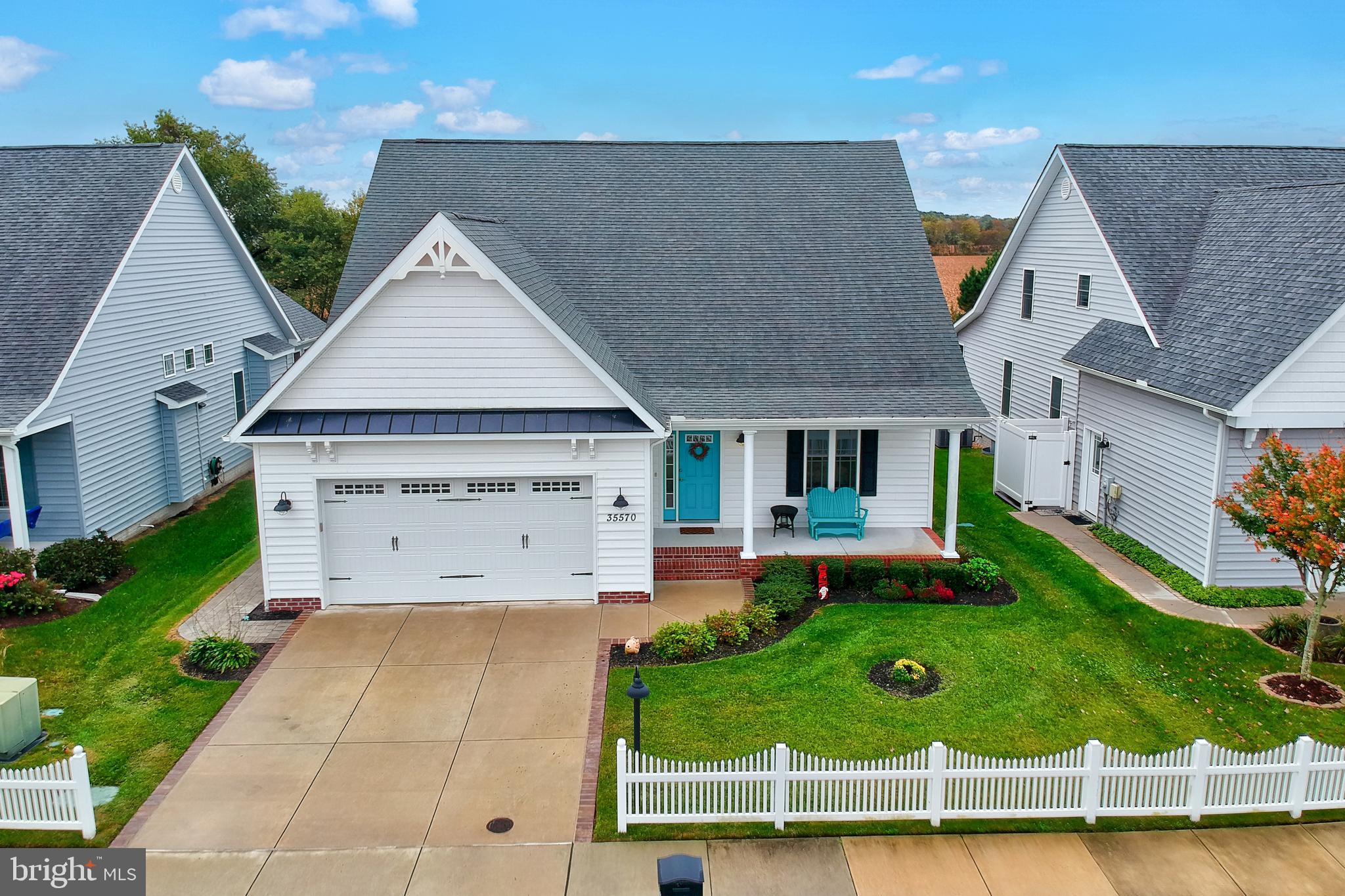 Stunning coastal get away!  Set off by a white picket fence, this bright and sunny home is sure to d