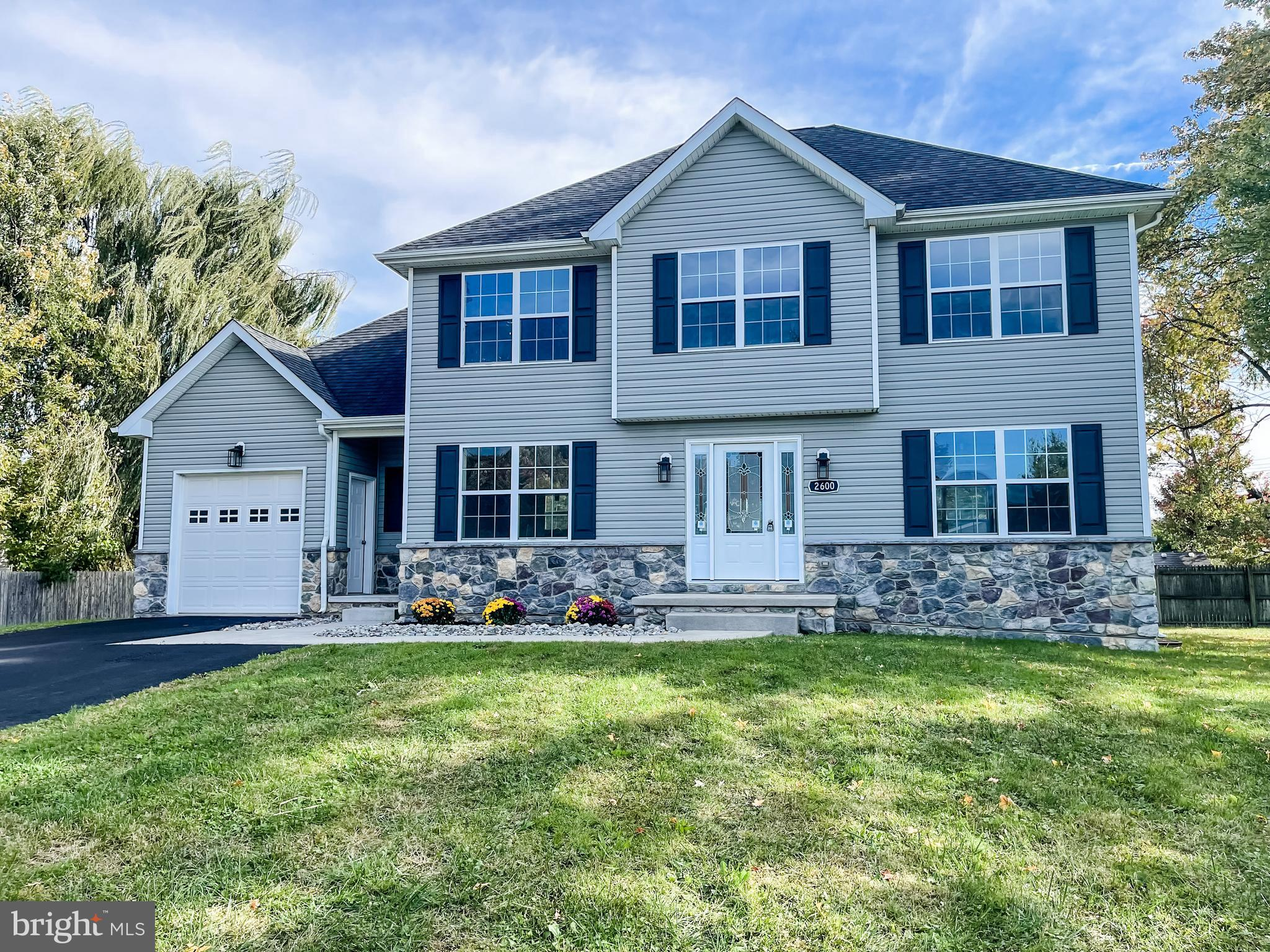 Welcome to this exquisite, custom built home conveniently located in North Wilmington. Featuring 4 b