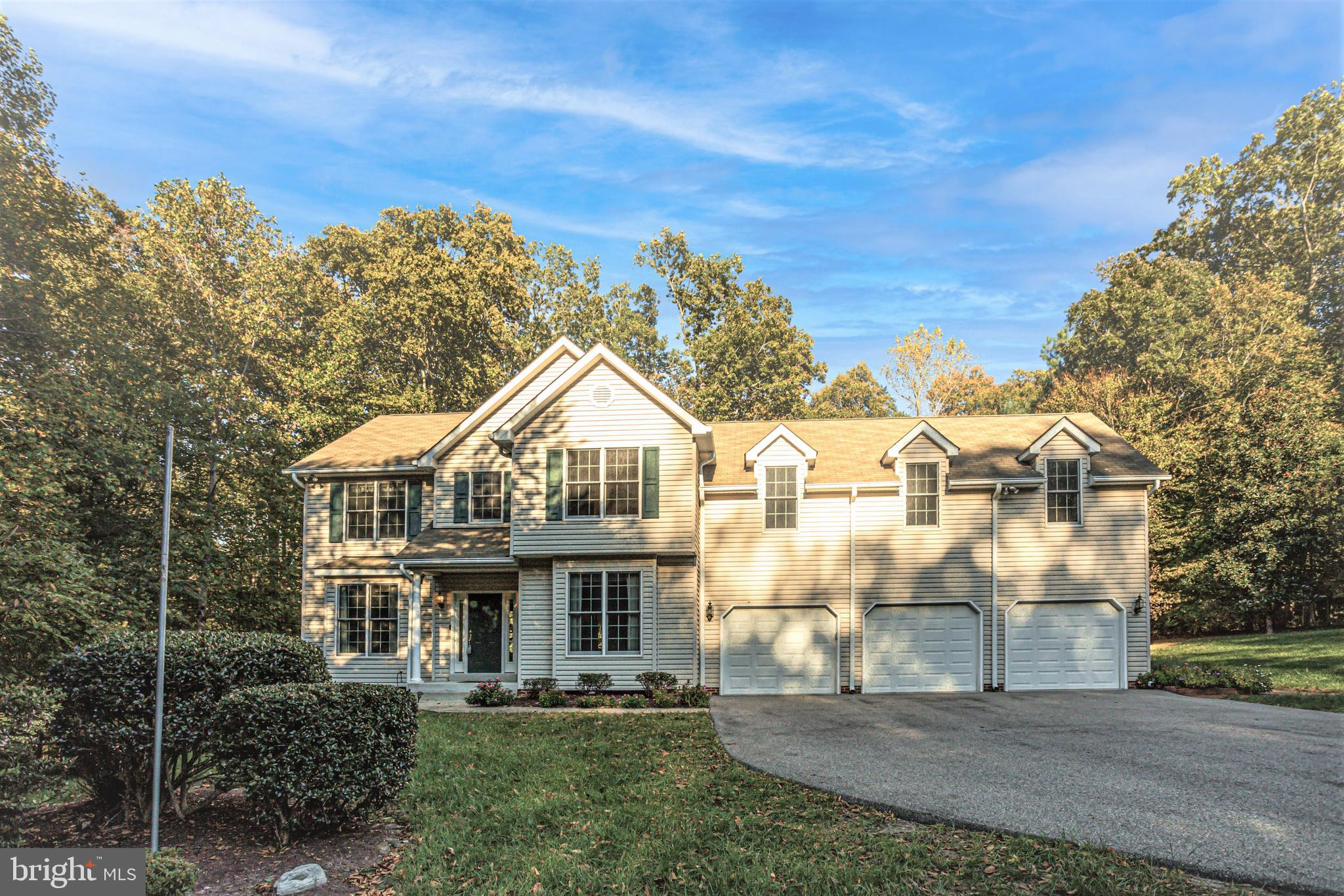 BIG BOLD BEAUTY!! Peace and Tranquility abound at this expansive home on 3.82 Acres of private woode