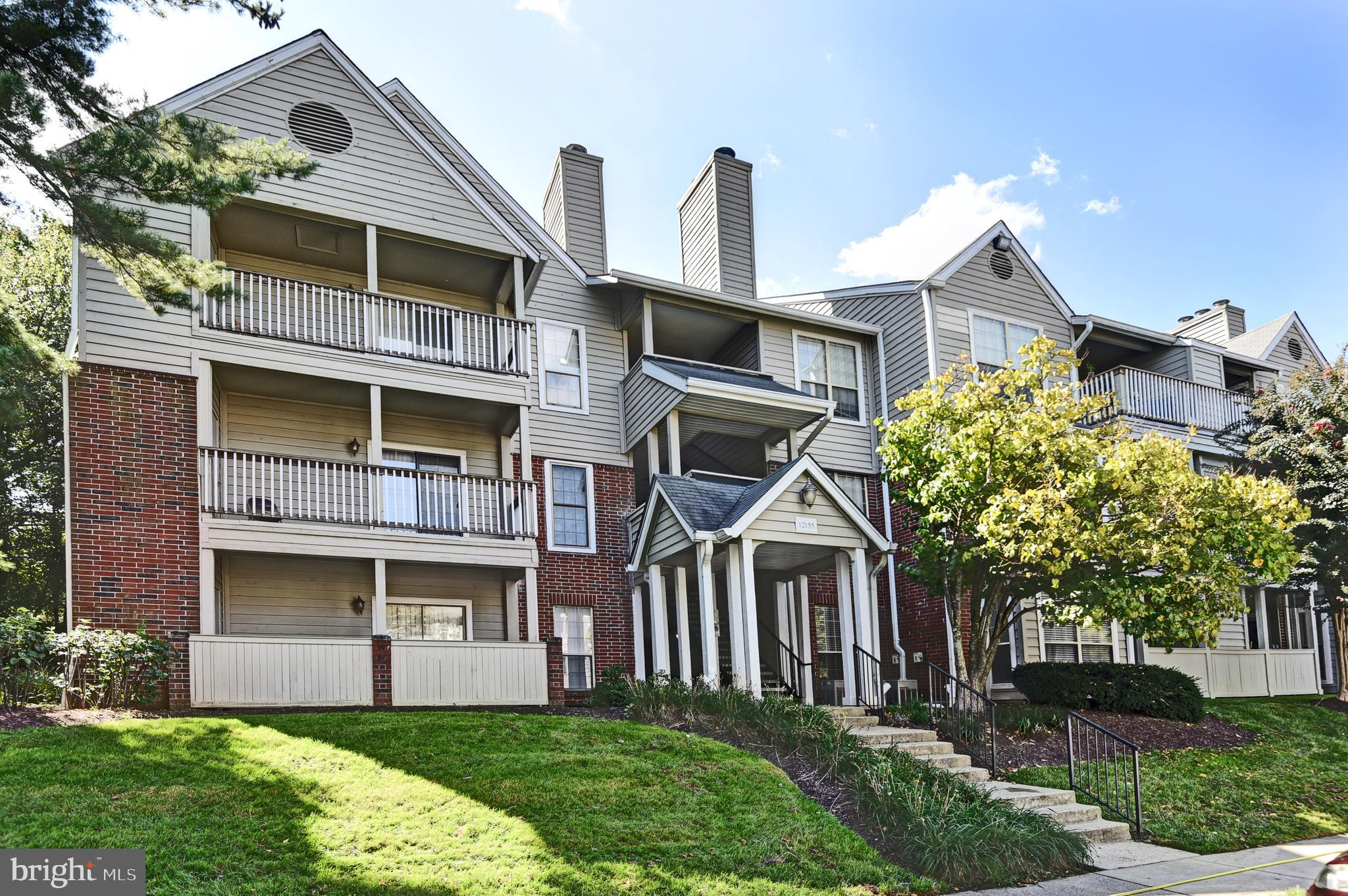Top floor renovated Condo with a large private Balcony overlooking mature trees!  This open floorpla
