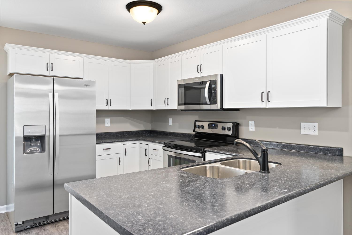 Check Out This Amazing New Construction townhome located close to Tennova Healthcare & Zoned for Rossview - Stainless Steel Appliances - Granite Counters in the Kitchen is Standard Selection - LVT Floors Installed on Main Level - Community Clubhouse & Pool - Pick Between 8 Different Selection Packages BEFORE September 15th