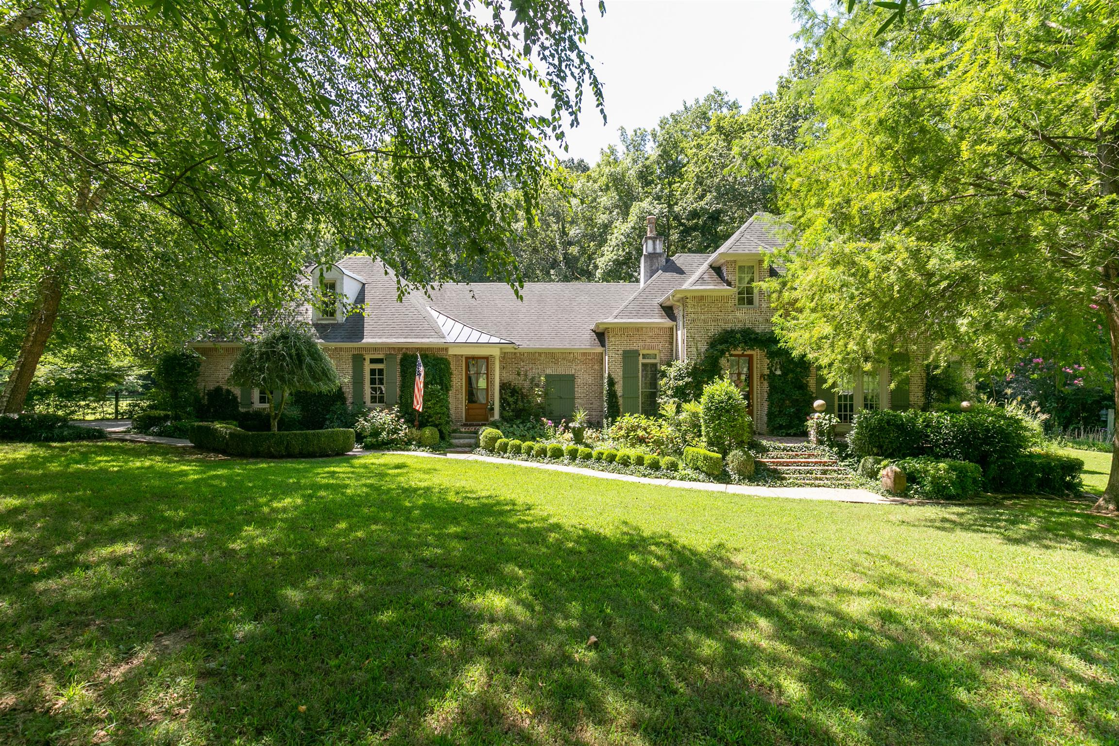 This is a WOW! ONE OF A KIND French Country manor with many custom features & upgrades! Short Commut