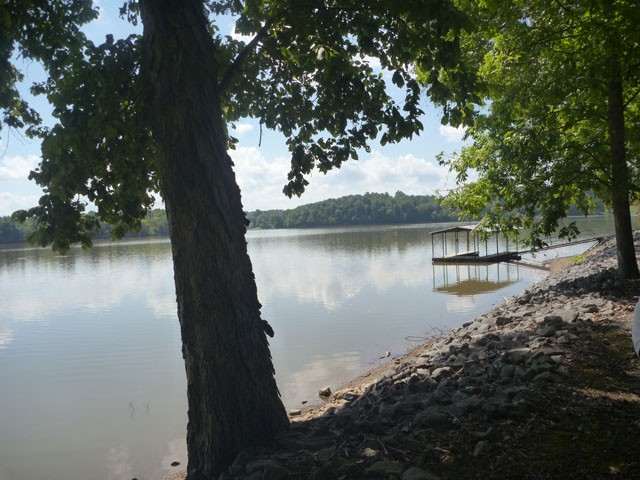 Lake Front Wooded Lot. Panoramic view of Little River off Barkley Lake with Dock Permit. Septic Tank Permit. Plat for house location. Water at the top of lot for hook up..Private sloping wooded lot.Boat to Barkley Lodge for dinner.Quick drive to Prizer Point Marina. Great facilities at both marina. Not fr from Barkley Dame and Kentucky Lake Dam. MOTIVATED SELLER !