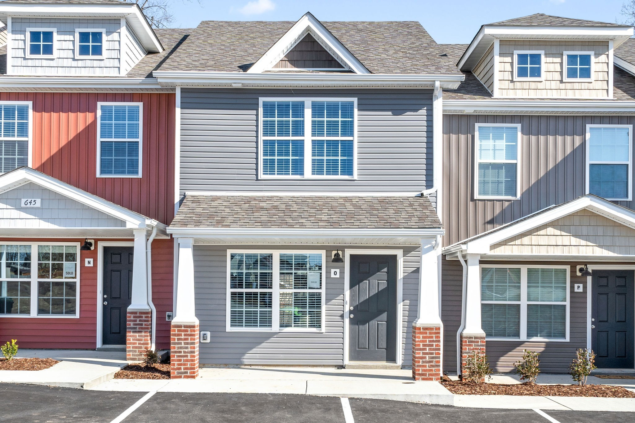 Check Out This Amazing New Construction Townhome located close to Tennova Healthcare & Zoned for Rossview School District in Professional Park Commons - Stainless Steel Kitchen Appliances to include Stove, Dishwasher & Range Microwave - Granite Counters in the Kitchen are Standard Selection - LVT Floors Installed on Main Level - COMPLETE & Ready for Immediate Closing!