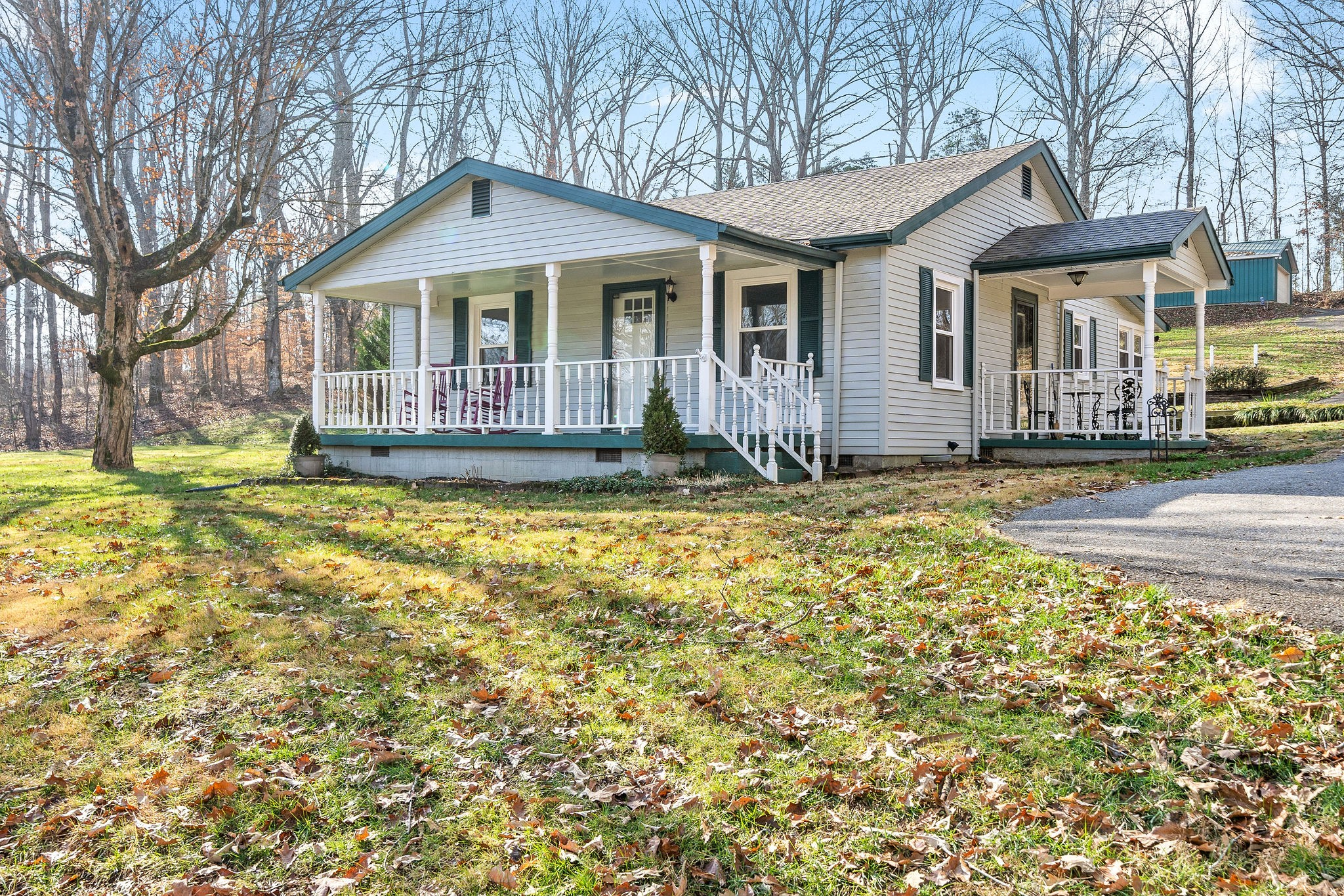 Oh my, this is perfect!  A 2bdr, 2ba cottage feel home sitting on just shy of 3 acres packed with its own punch!  The kitchen is updated with gas stove, SS appliances, subway tile, and granite counter tops!  Laminate flooring throughout, master suite, two porches, RV Parking w/hook up, 24x40 shop w/electric, another pad w/electric hook up, plenty of parking!  You have to see this home!