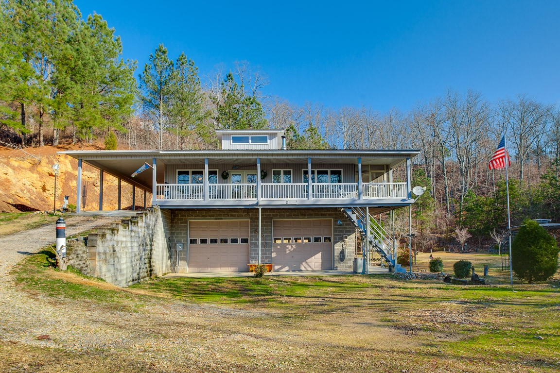 Magnificent lakefront beauty! Impeccably maintained home on almost 7 acres with direct access to the