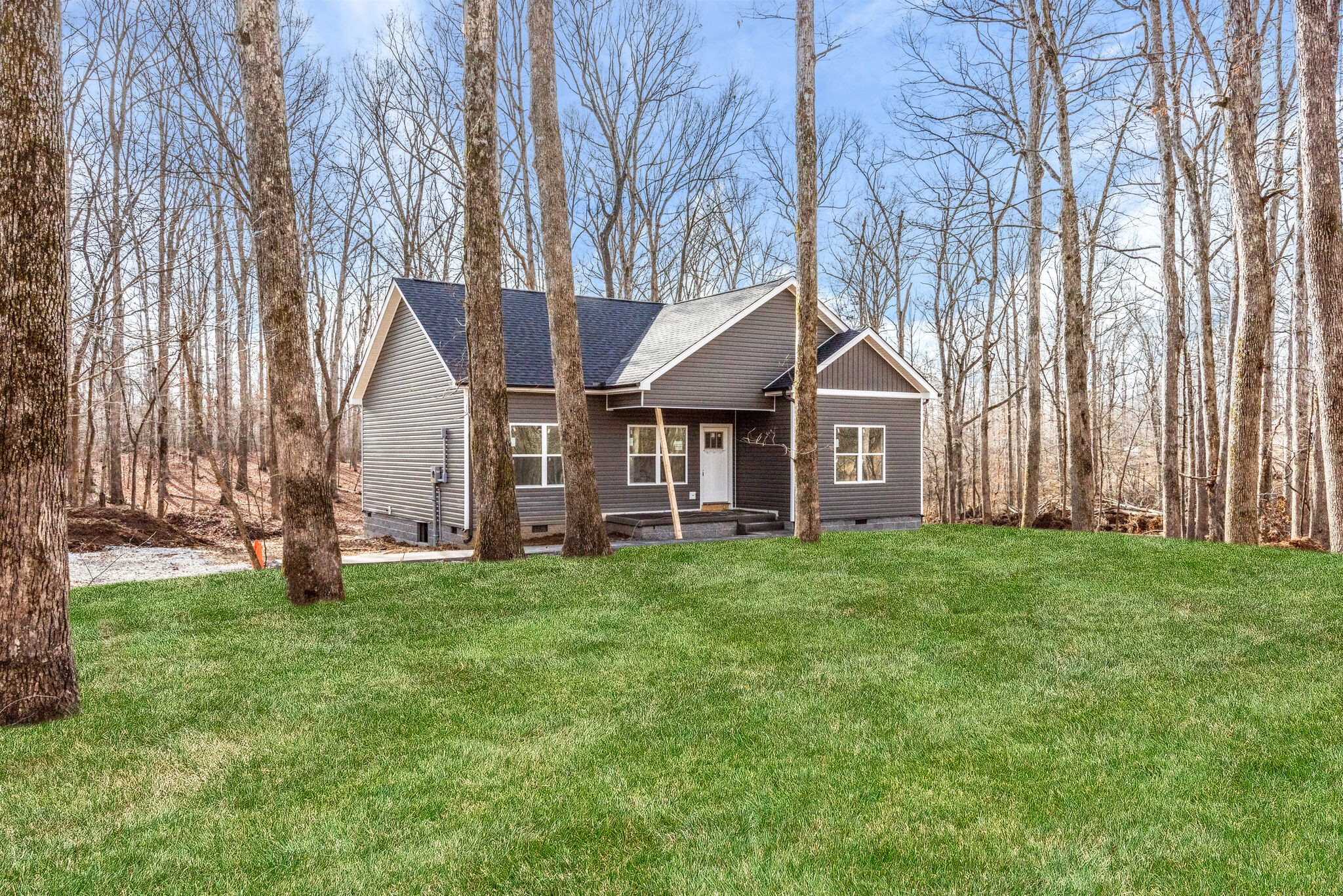 BRAND NEW HOME*SITUATED on 5.01 ACRES+/-*Awesome Country Setting-Land is GORGEOUS*ALL ONE LEVEL FLOO